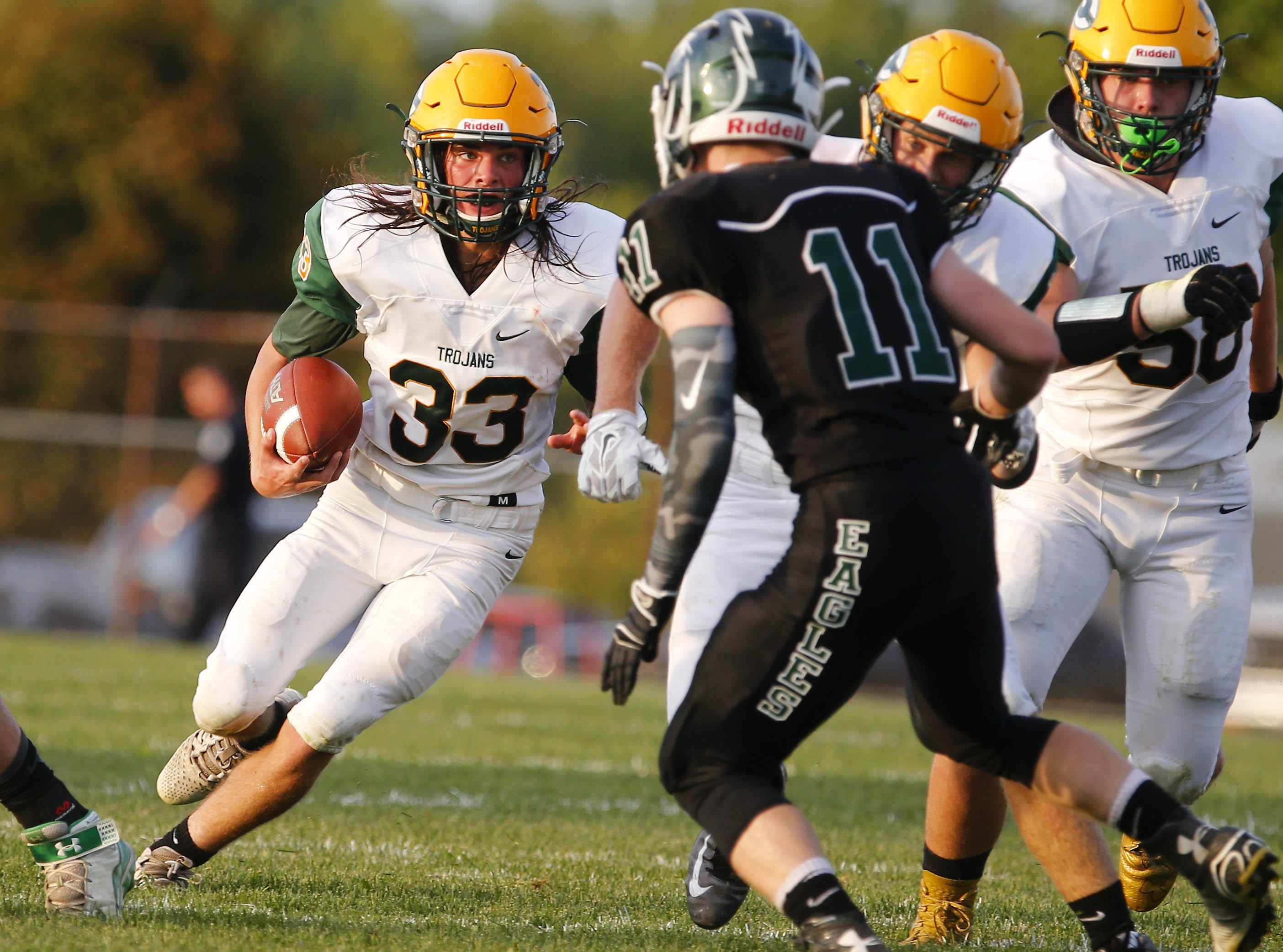 West Seneca East's Ian Dolac finds a hole during the first half of the game at Lake Shore on Friday night.