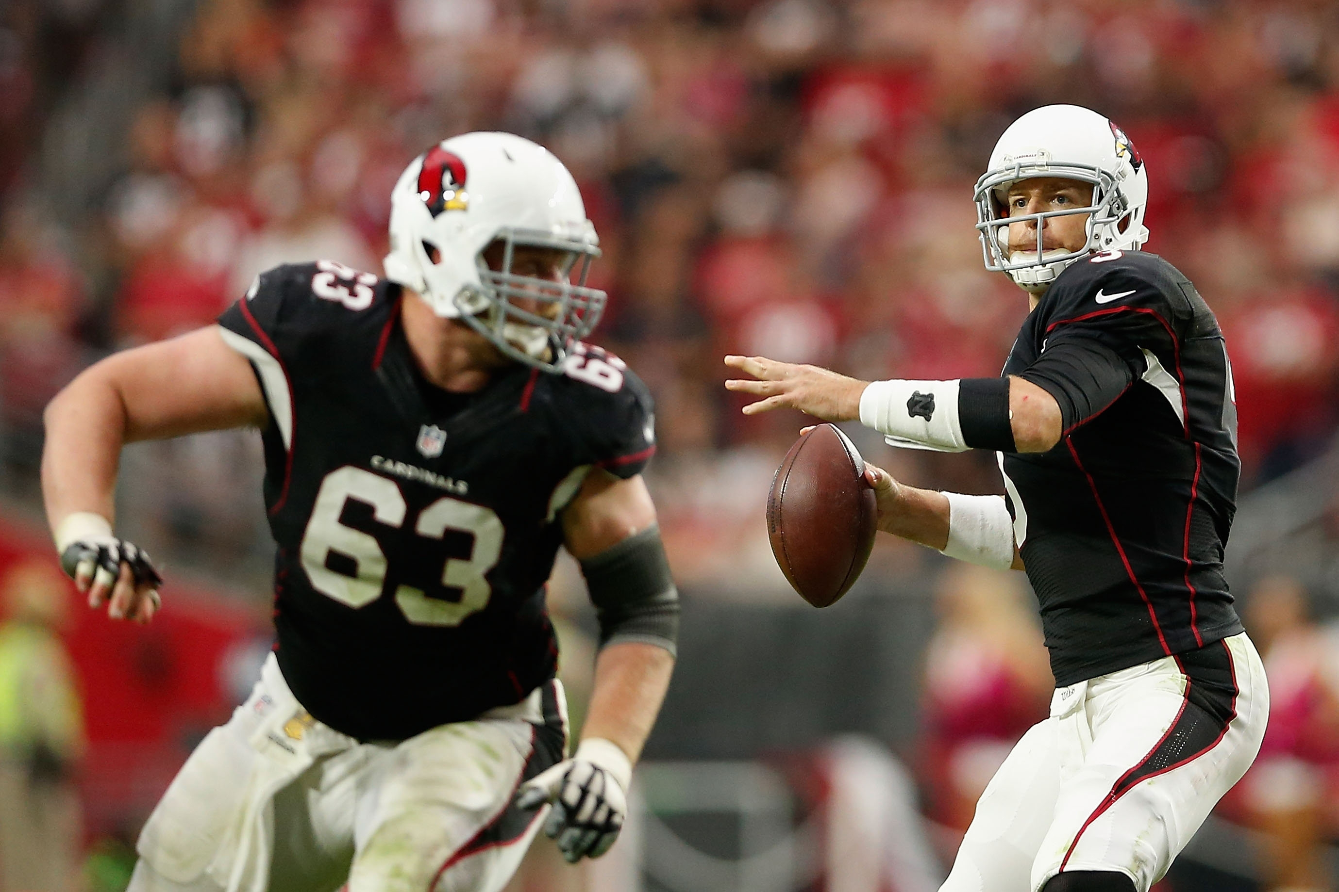 Arizona Cardinals quarterback Carson Palmer is coming off a tremendous regular season in which he threw for 35 touchdowns, 4,671 yards and a 104.5 passer rating. The Cards led the league in offense in 2015. (Getty Images)
