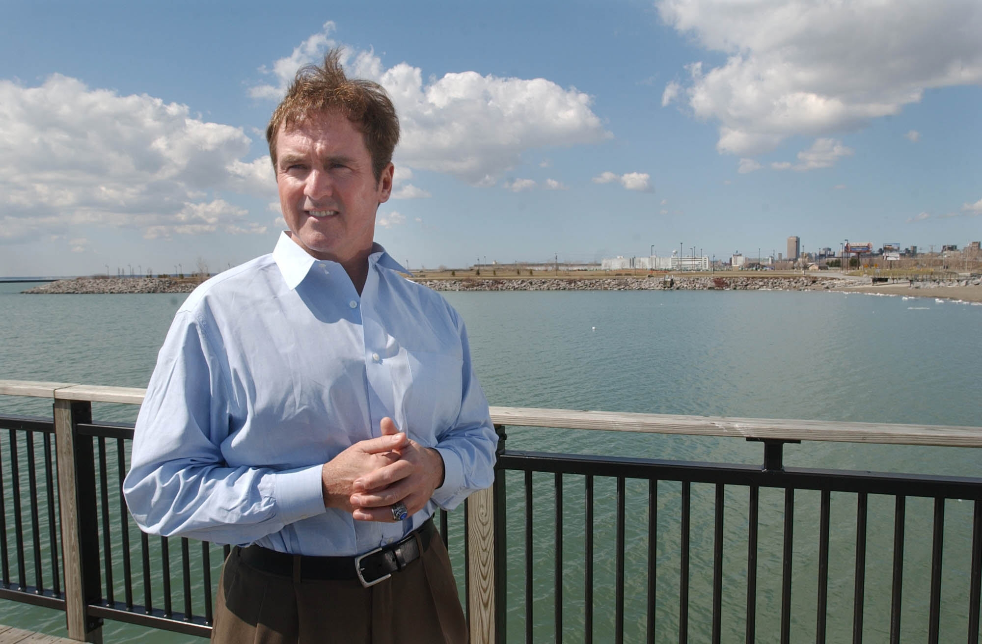 4/8/05 --  Congressman Brian Higgins on the fishing pier at Gallagher Beach, which was result of the first part of a waterfront revitalization project Higgins enacted as state assemblyman.  He wants to use his new position as congressman to enact more comprehensive projects.   Photo by Derek Gee  FOR DOUG TURNER STORY