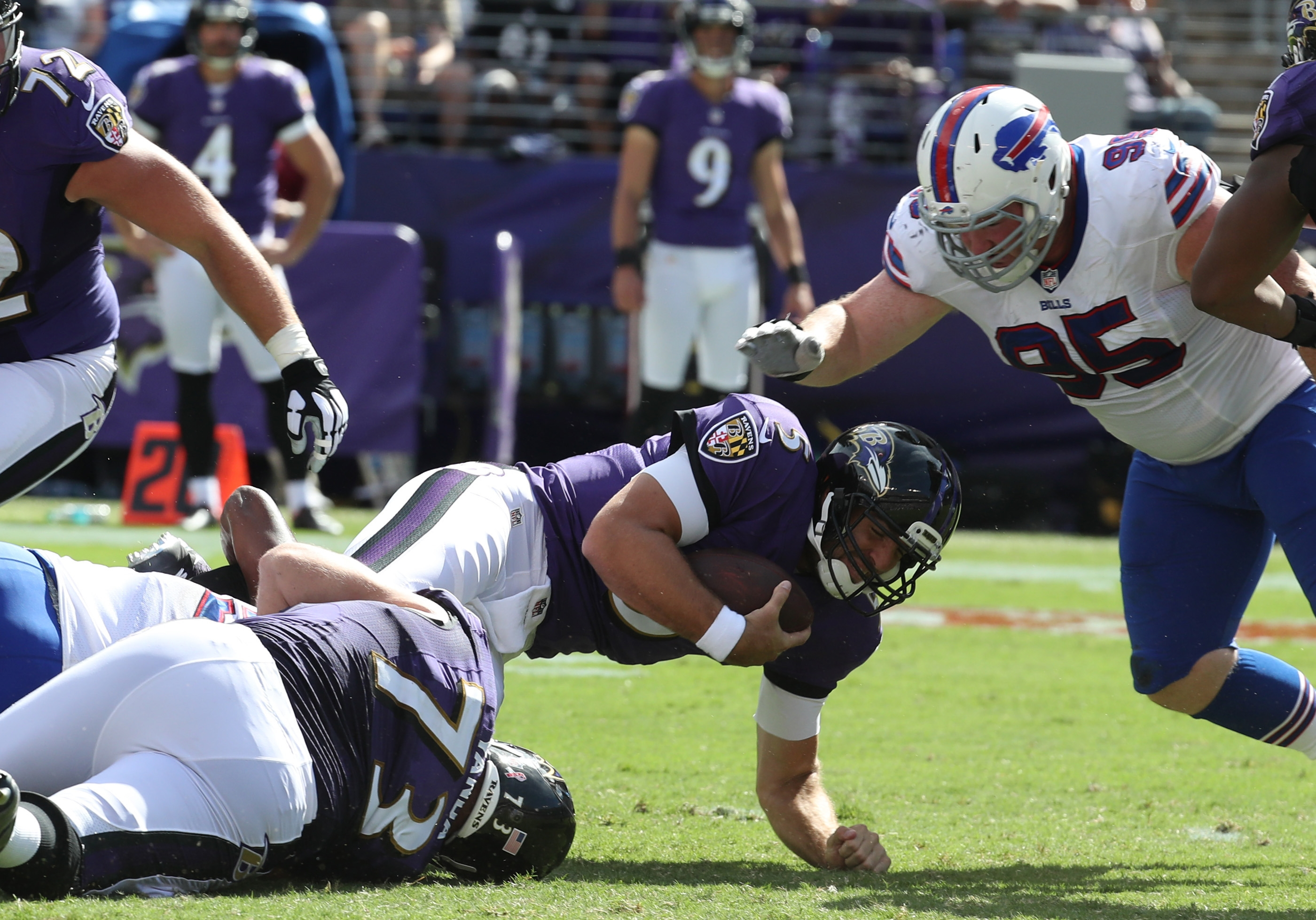 Joe Flacco is sacked by Buffalo Bills defensive end Jerry Hughes (55) in the third quarter.