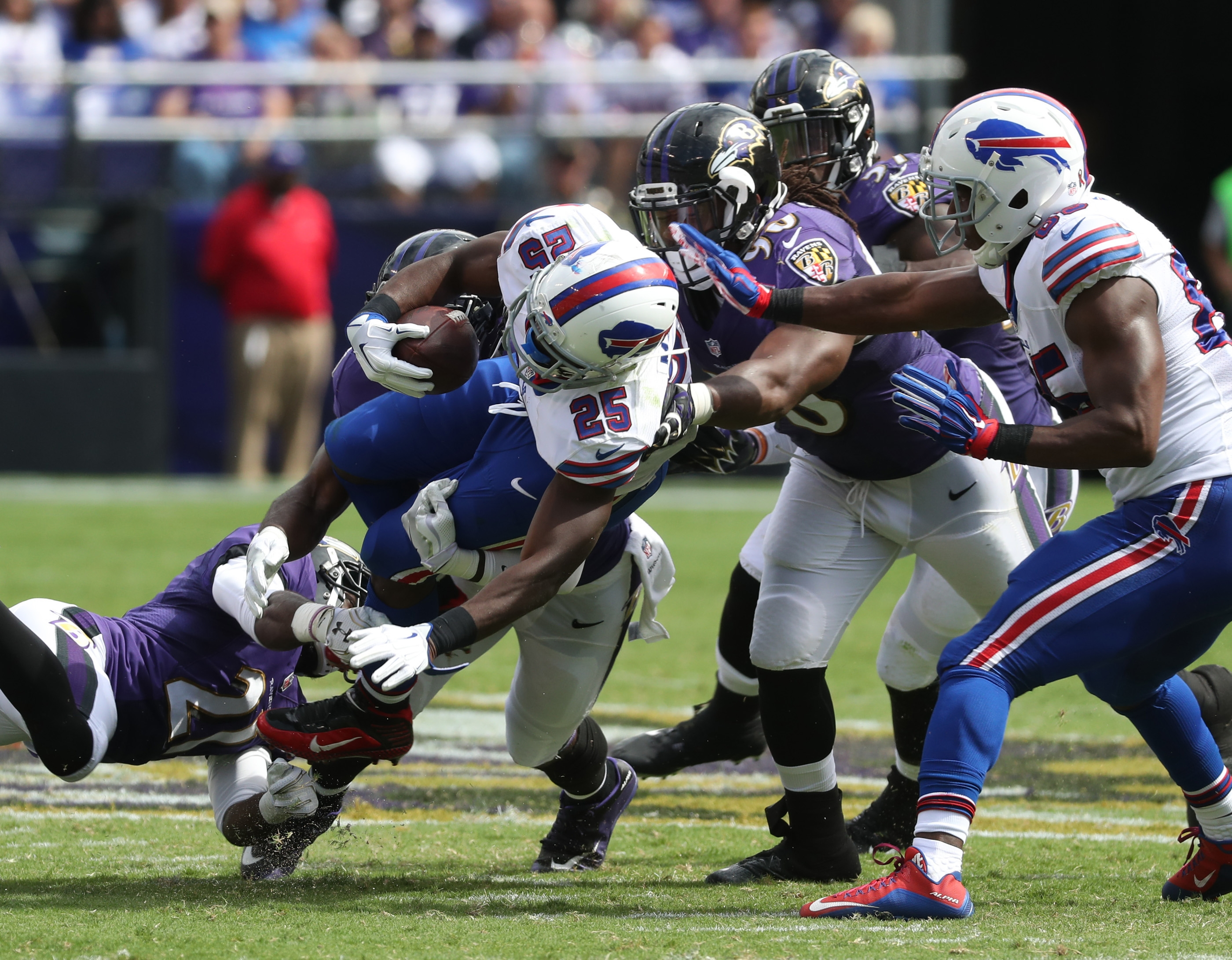 LeSean McCoy (25) is tackled by Baltimore Ravens cornerback Kyle Arrington (24) for a loss in the third quarter.
