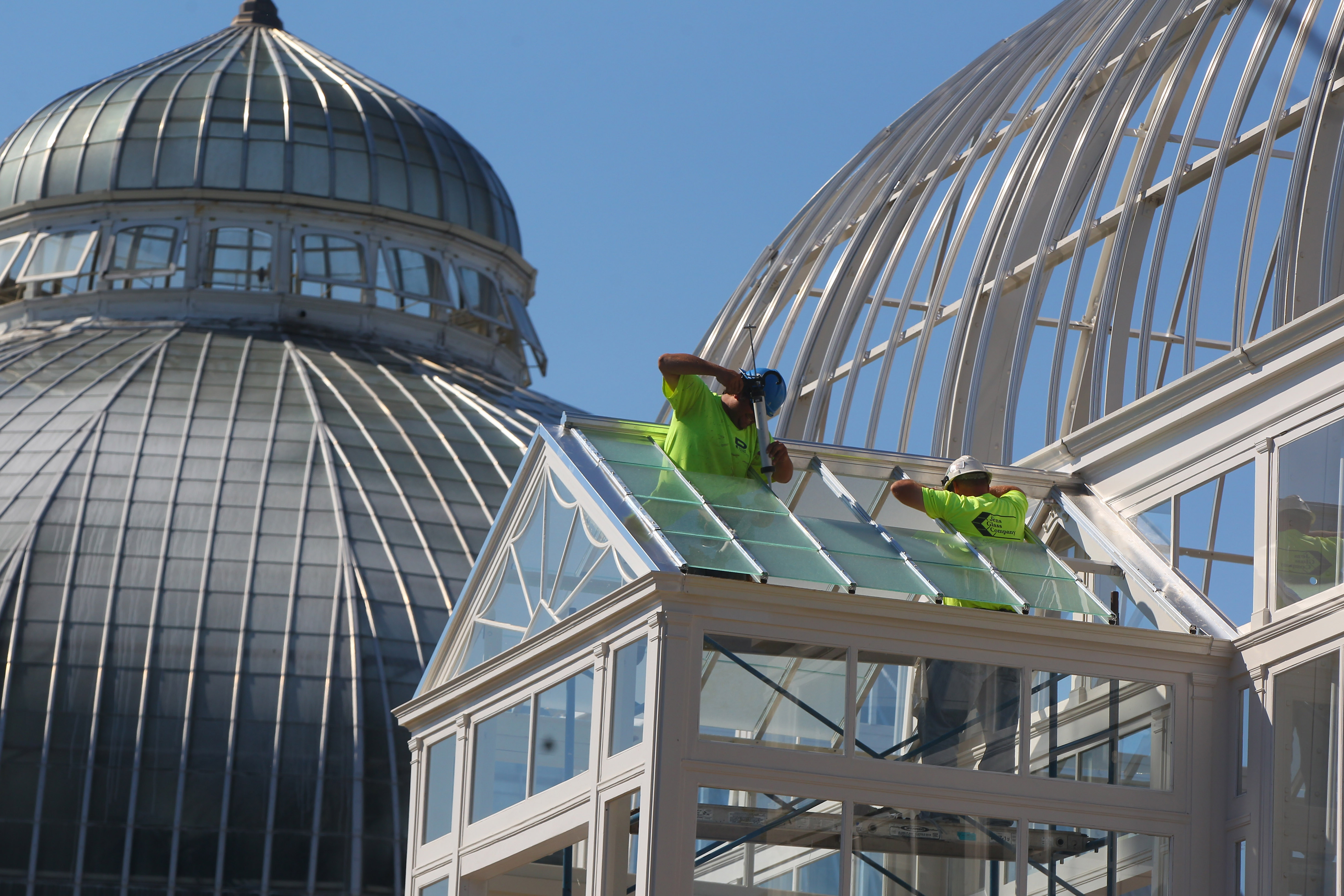 Window glaziers Brian Cruber, left, and Mike Nowakowski install glass panels Tuesday as work continues on the renovations at the Buffalo and Erie County Botanical Gardens in South Buffalo. Two new exhibits will open in two refurbished greenhouses.