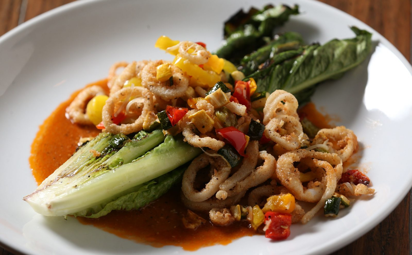 Fried calamari and zucchini, tomato, Parmesan, banana peppers and parsley with a spicy tomato basil dressing. (Sharon Cantillon/Buffalo News)