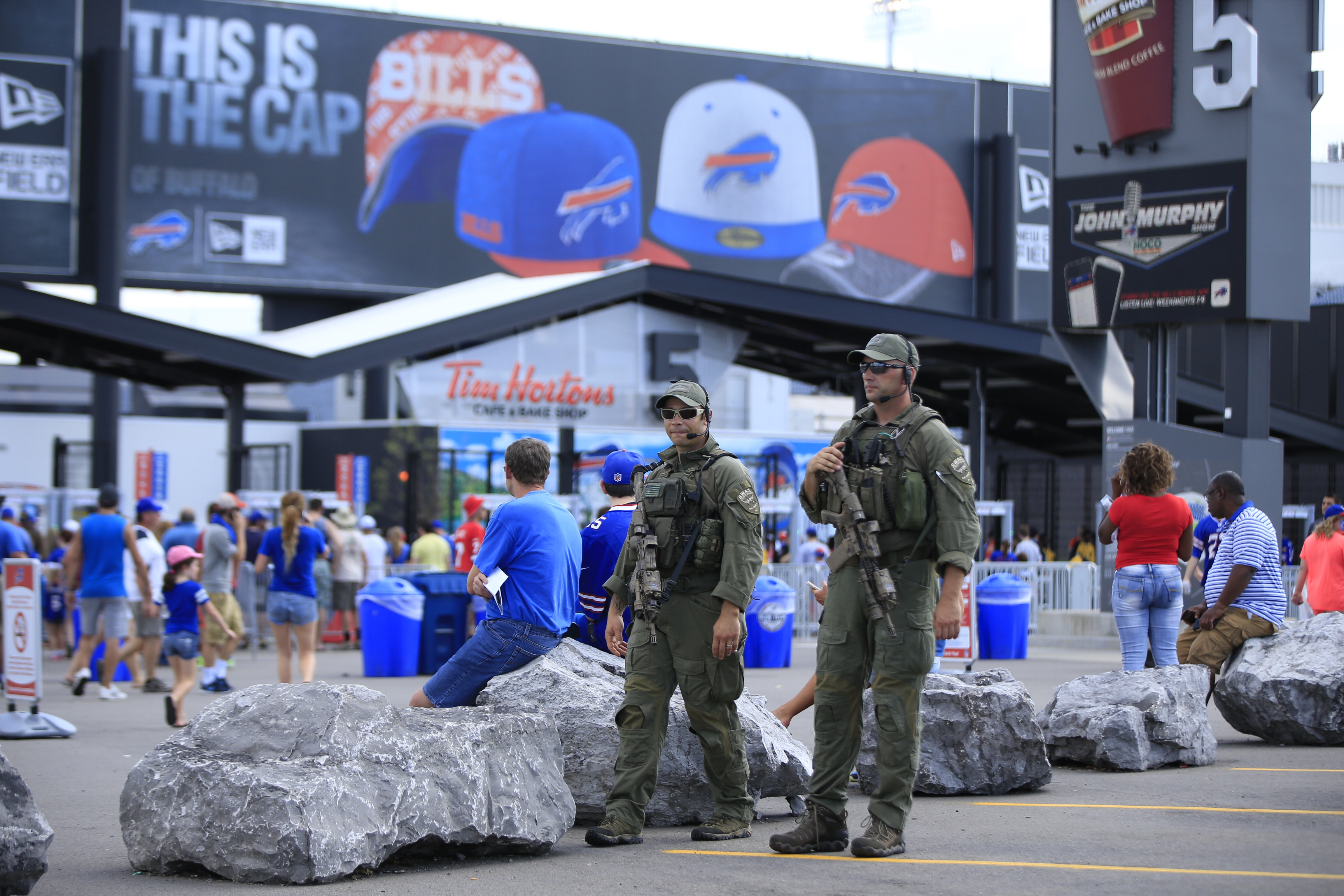 Erie County SWAT team members Ben Pisa and Matt Noecker walk the outside perimiter of New Era Field prior to the Buffalo Bills and New York Giants game on Saturday, Aug. 20, 2016. (Harry Scull Jr./Buffalo News)