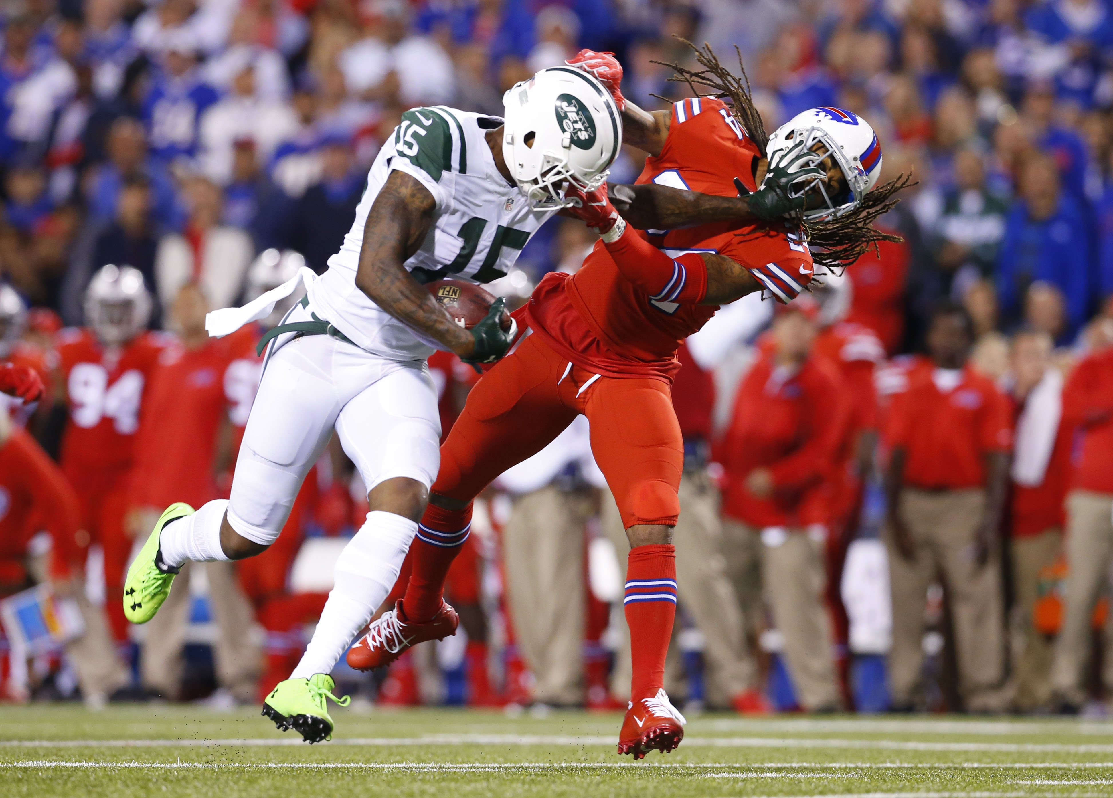 Bills cornerback Stephon Gilmore, right, wraps up New York Jets wide receiver Brandon Marshall during the first quarter at New Era Field Thursday.