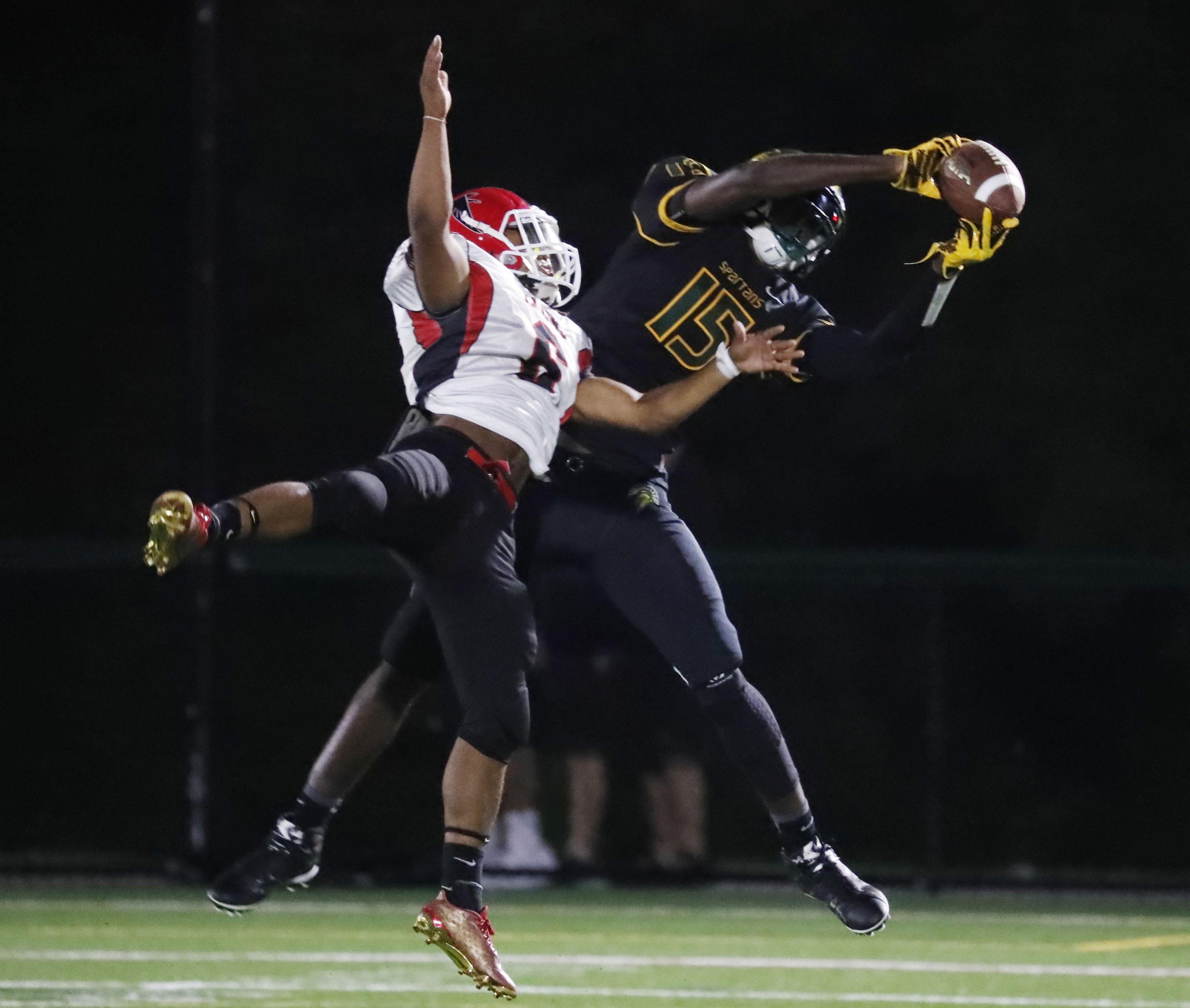 Williamsville North's Jairus Huggins catches a touchdown pass against Niagara-Wheatfield during Friday's game.
