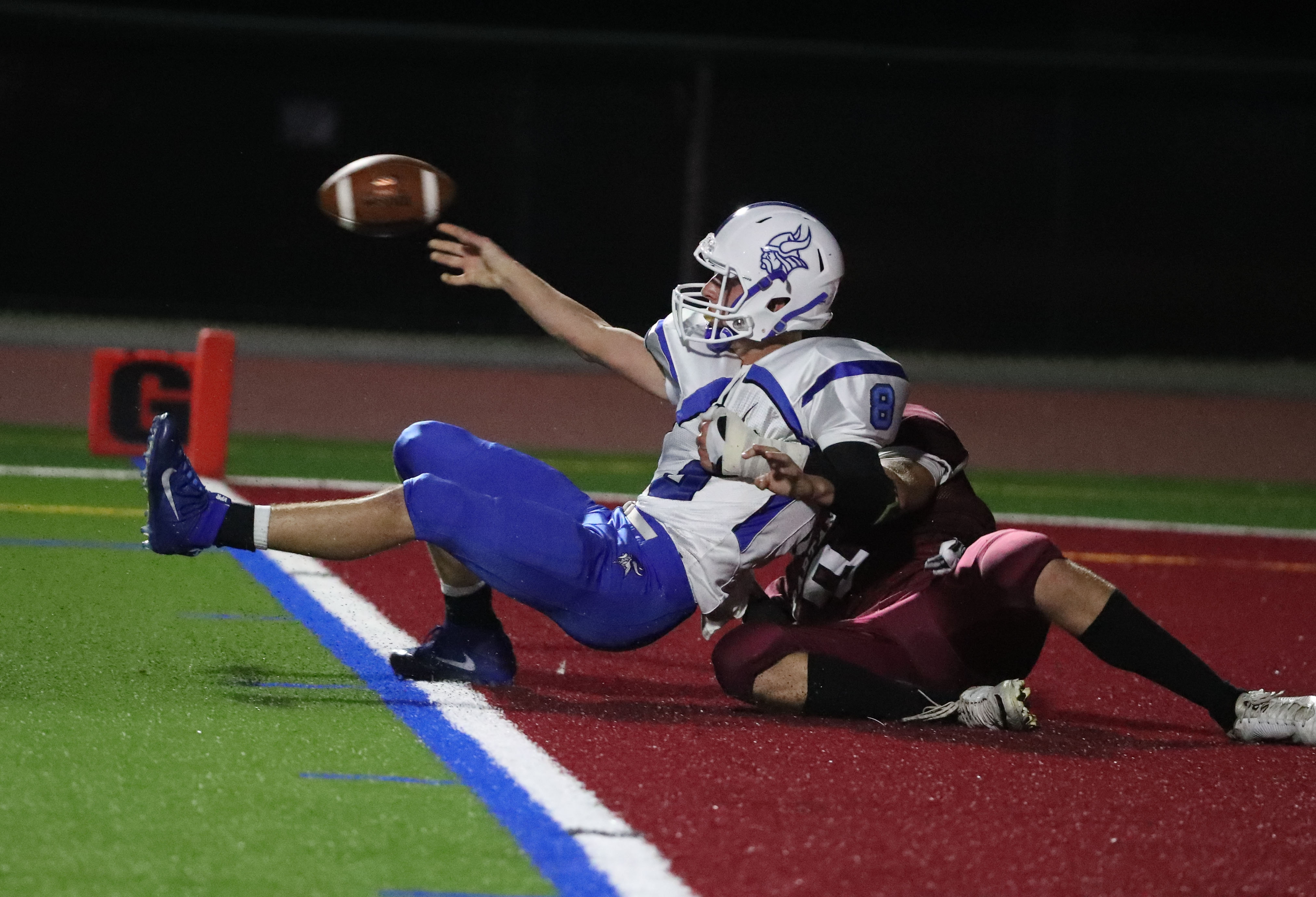 Austin Meenaghan of Starpoint takes down Grand Island quarterback Cam Sionko, who was whistled for intentional grounding, resulting in a safety in the second quarter.