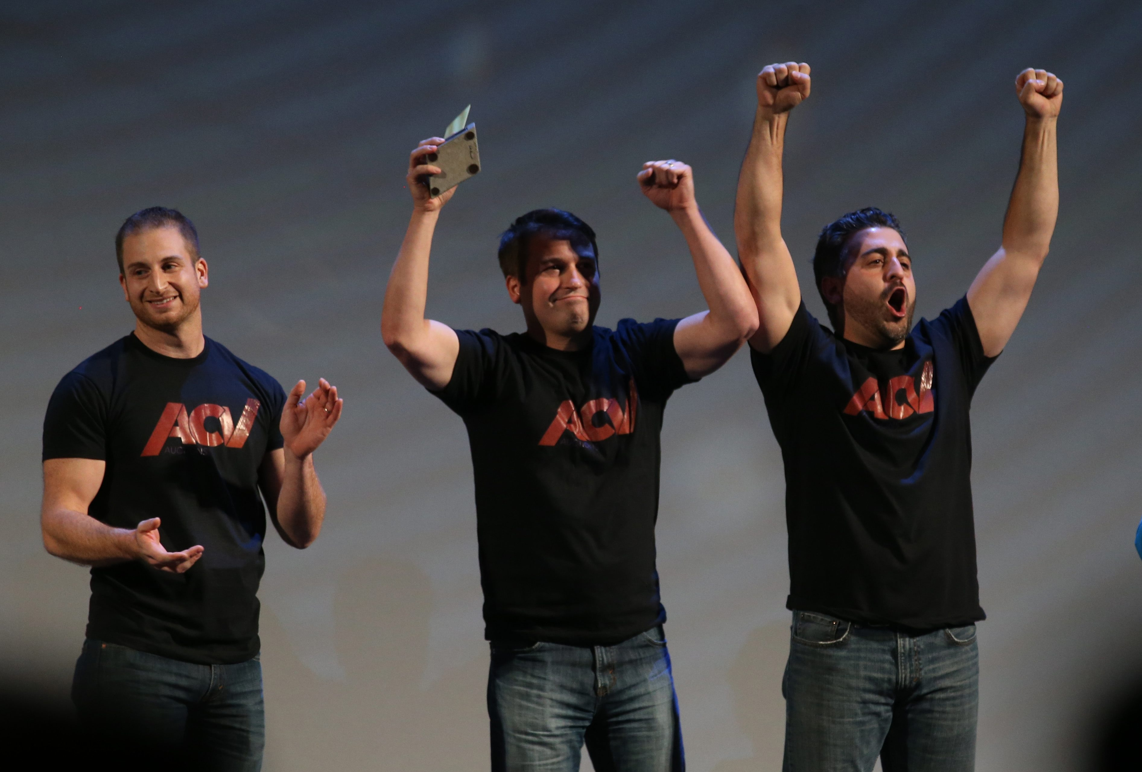 ACV Auctions won the million dollars in the 43 North business plan competition during which was announced at Shea's Performing Arts Center, Thursday, Oct. 29, 2015.  ACV Auctions is a live wholesale marketplace for dealer-only wholesale auctions, conducted via a smartphone app. From left are Joe Nieman, Dan Magnuszewski and Jack Greco.  (Sharon Cantillon/Buffalo News)