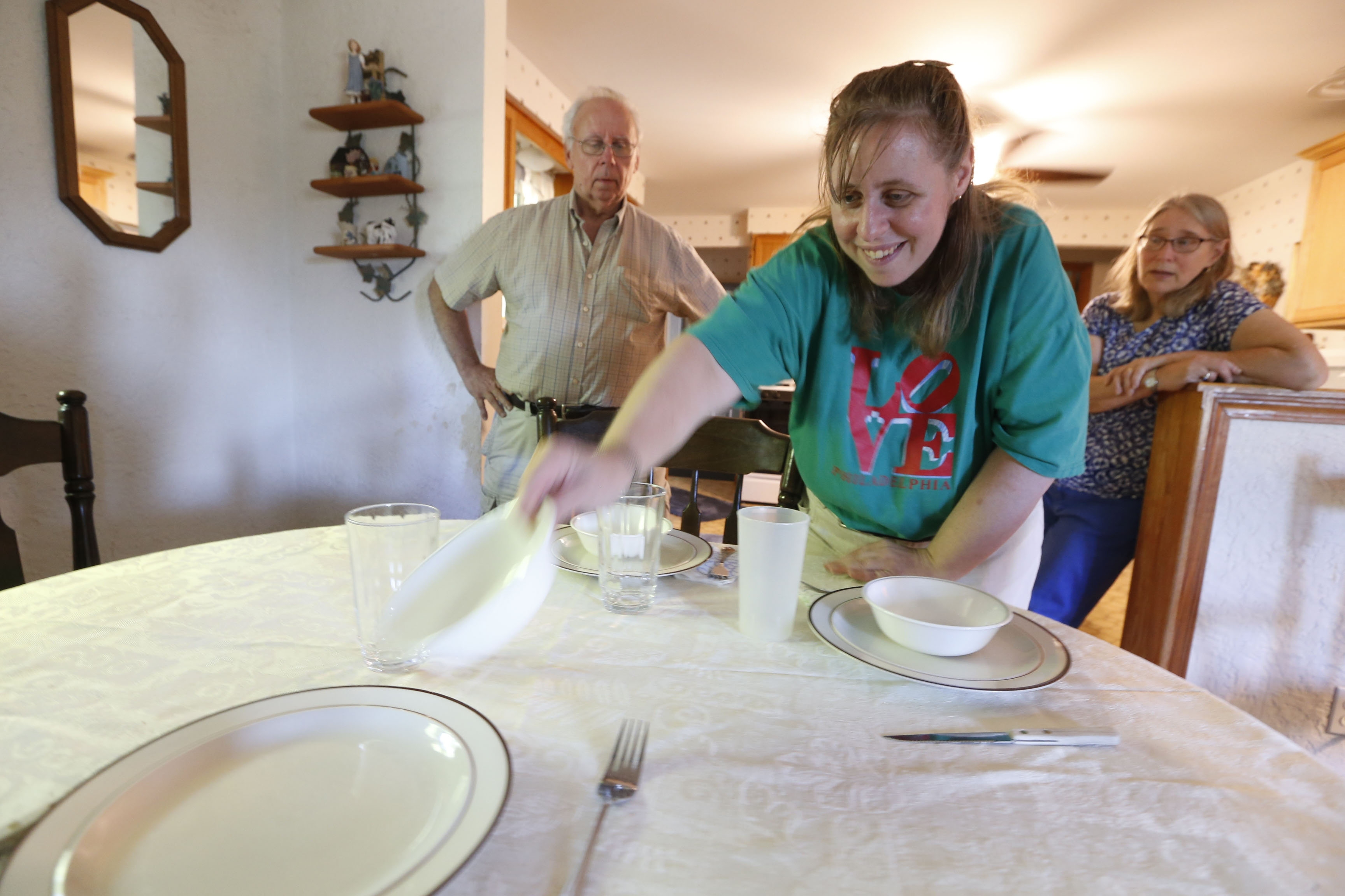 Here's Amanda setting the table. This is the story of Richard and Dawn DiCarlo with their 41-year-old daughter, Amanda.  This was at their Cheektowaga home on Thursday, Sept. 1, 2016.  (Robert Kirkham/Buffalo News)