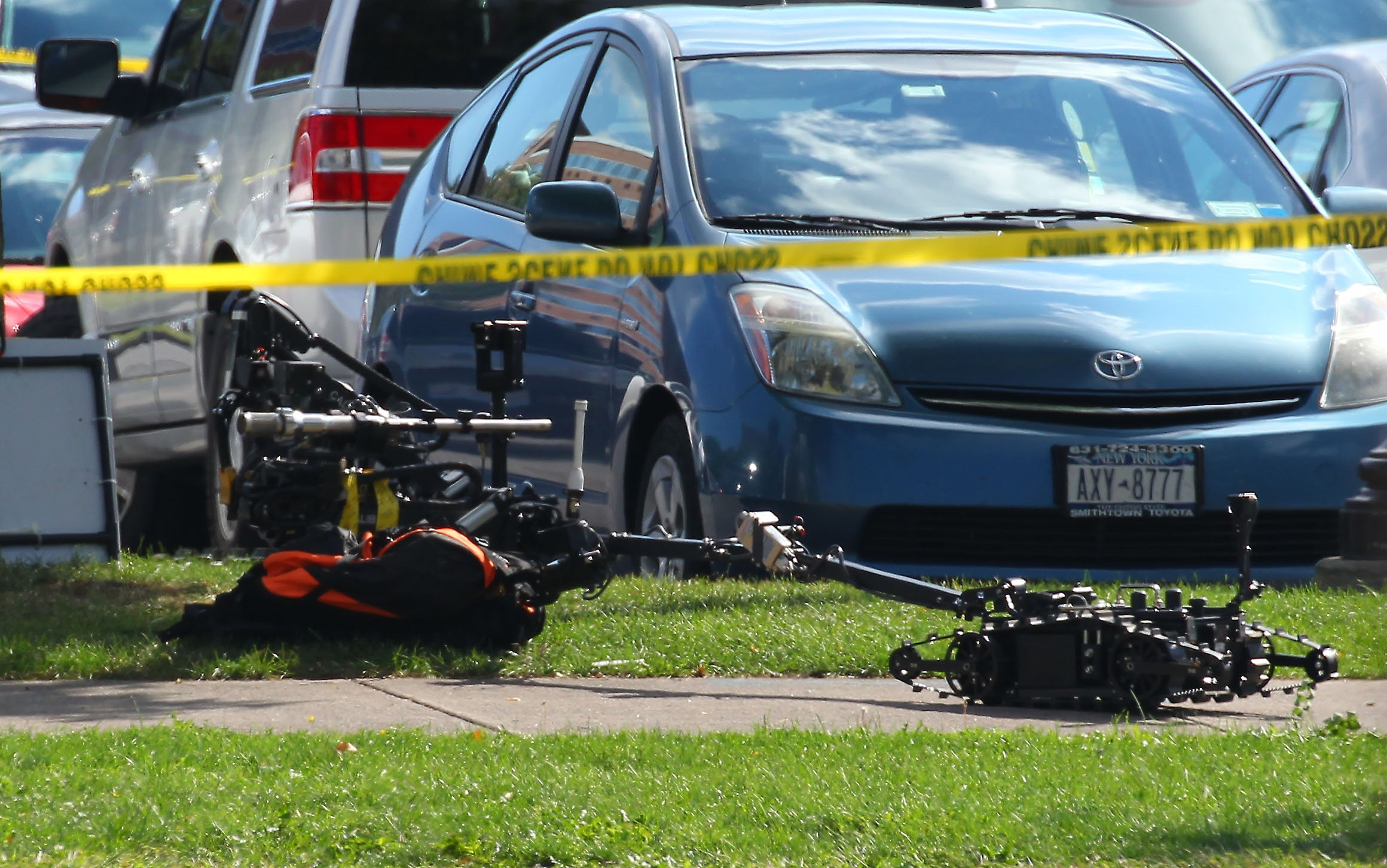Robots investigate a suspicious backpack in a parking lot in Niagara Falls Monday, Sept. 19, 2016.  (Mark Mulville/Buffalo News)