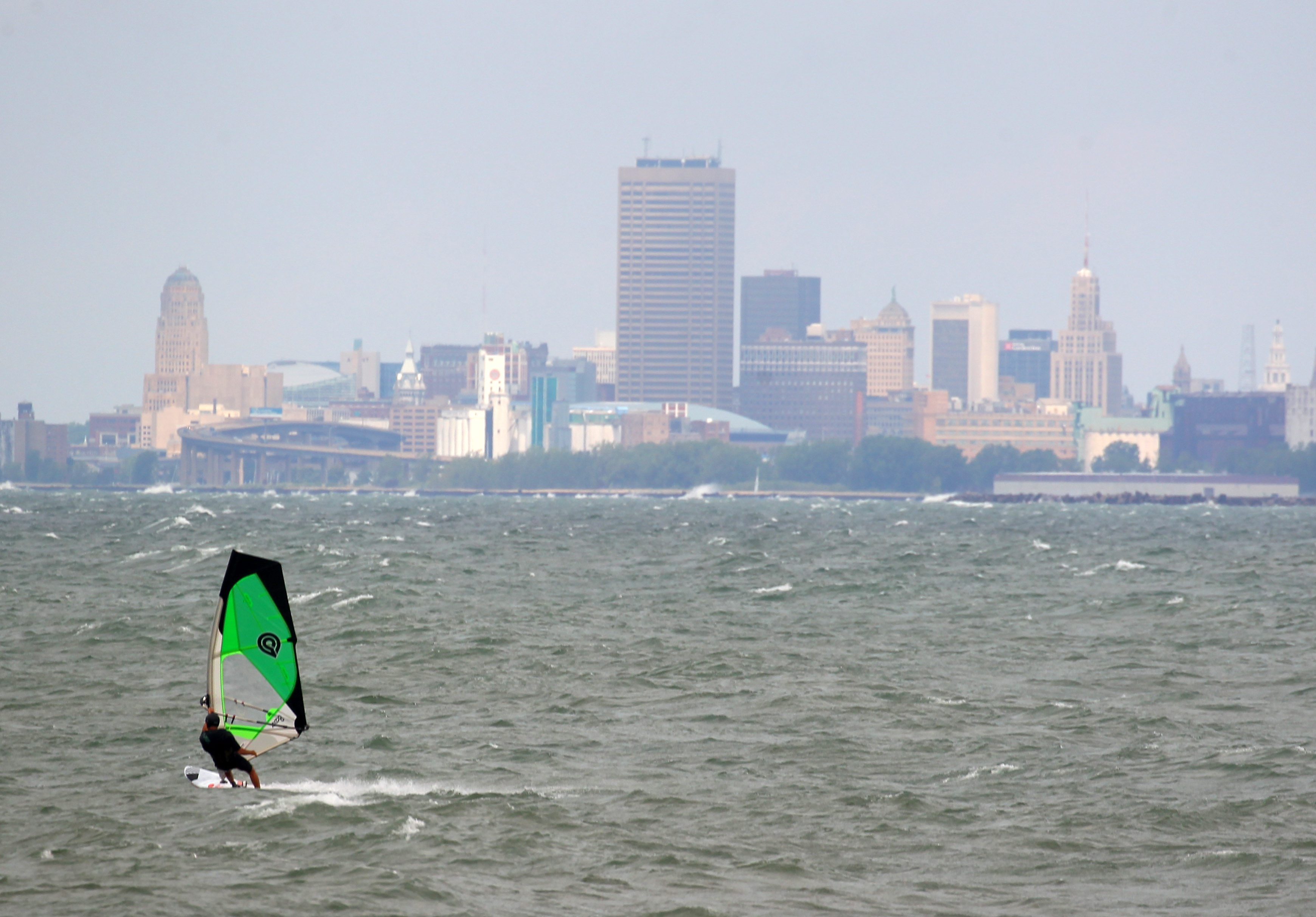 A wind surfer glides throughout the water off of Hamburg Beach in Hamburg Monday, July 18, 2016.       (Mark Mulville/Buffalo News)