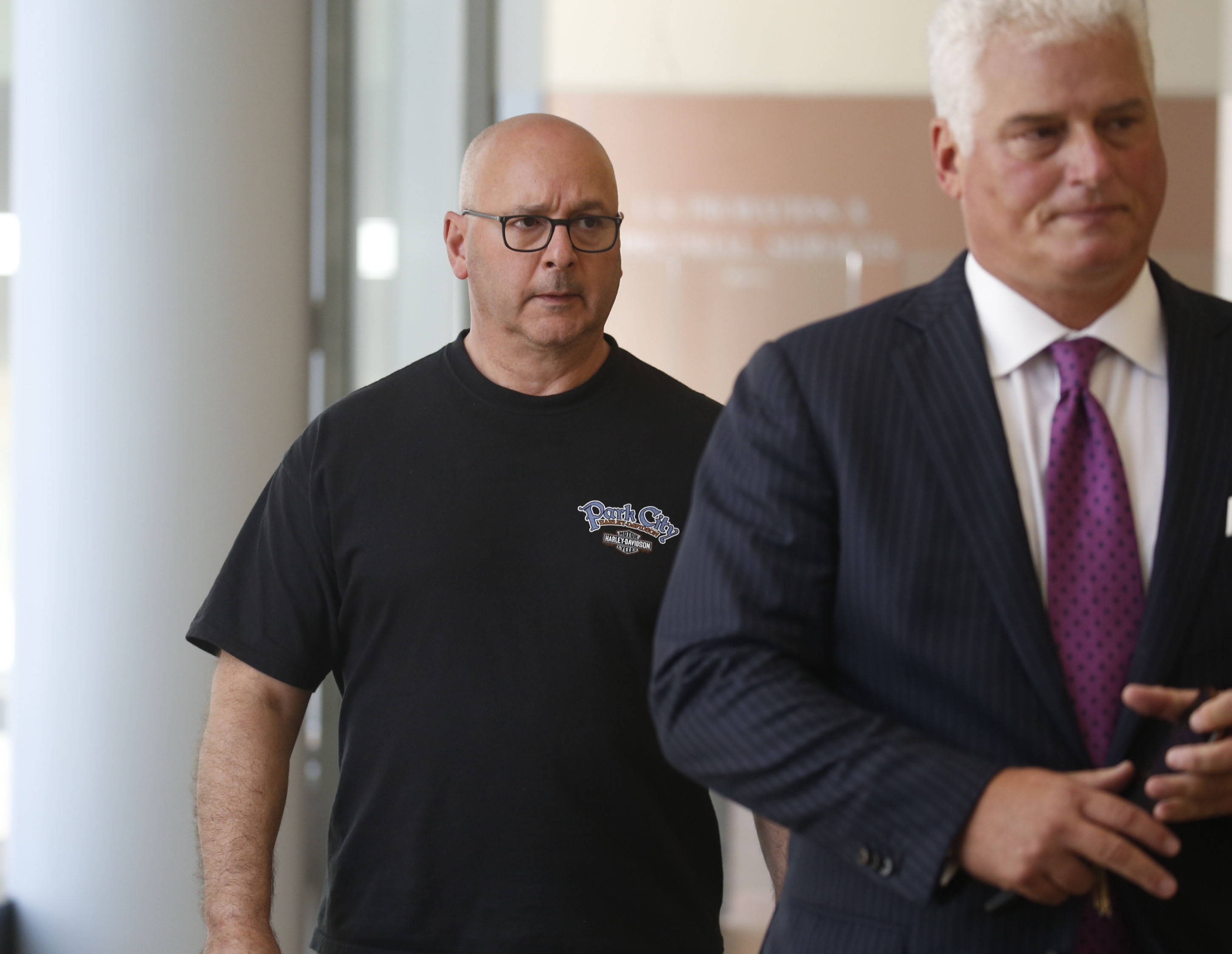 Louis P. Ciminelli, left, gets escorted out of court with his attorney Daniel C. Oliverio, right, after facing charges of  rigging and bribery at Buffalo federal court on Thursday, Sept. 22, 2016.  (Robert Kirkham/Buffalo News)