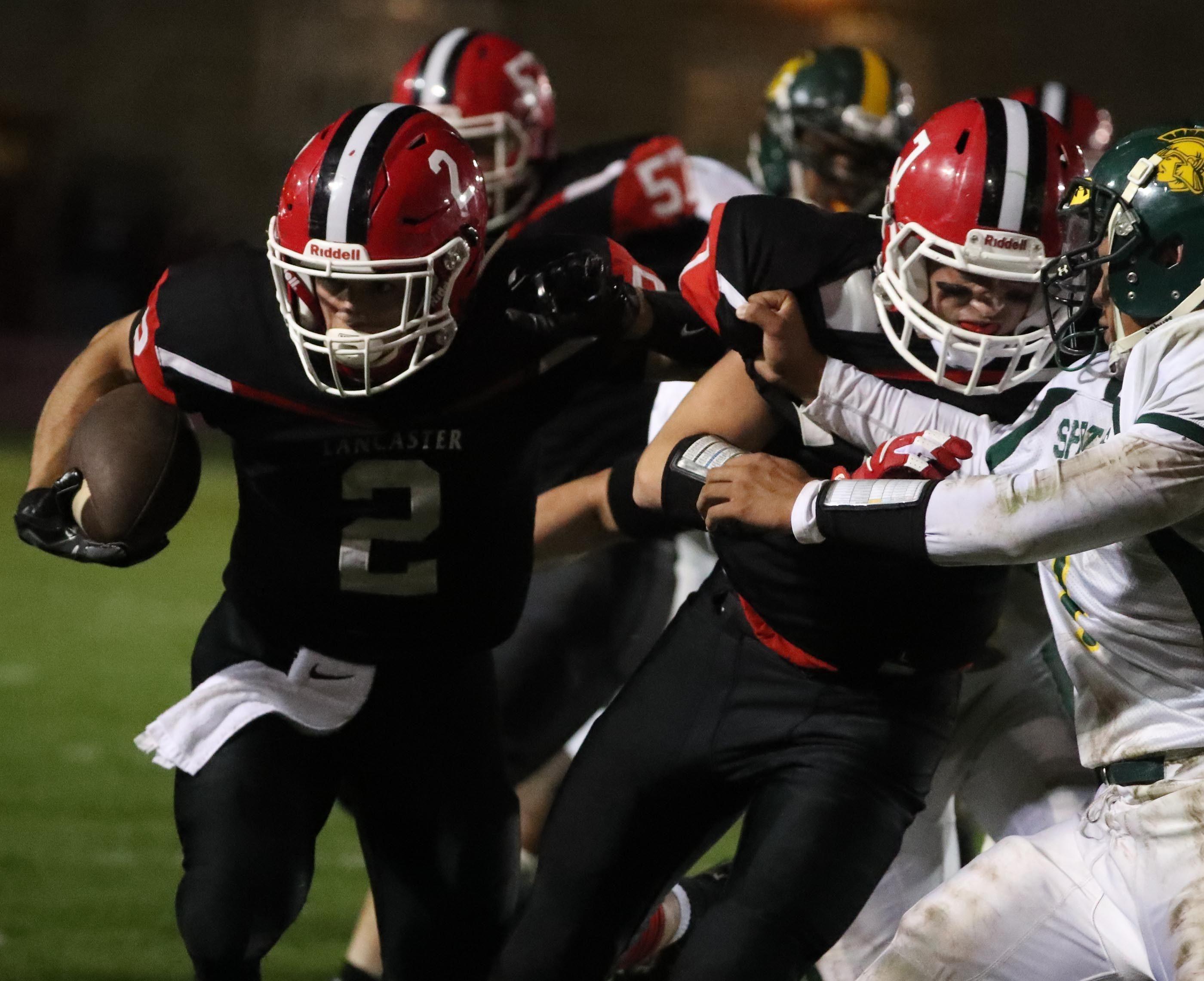 Lancaster's Zach Samborski rushes for a first down against Williamsville North.