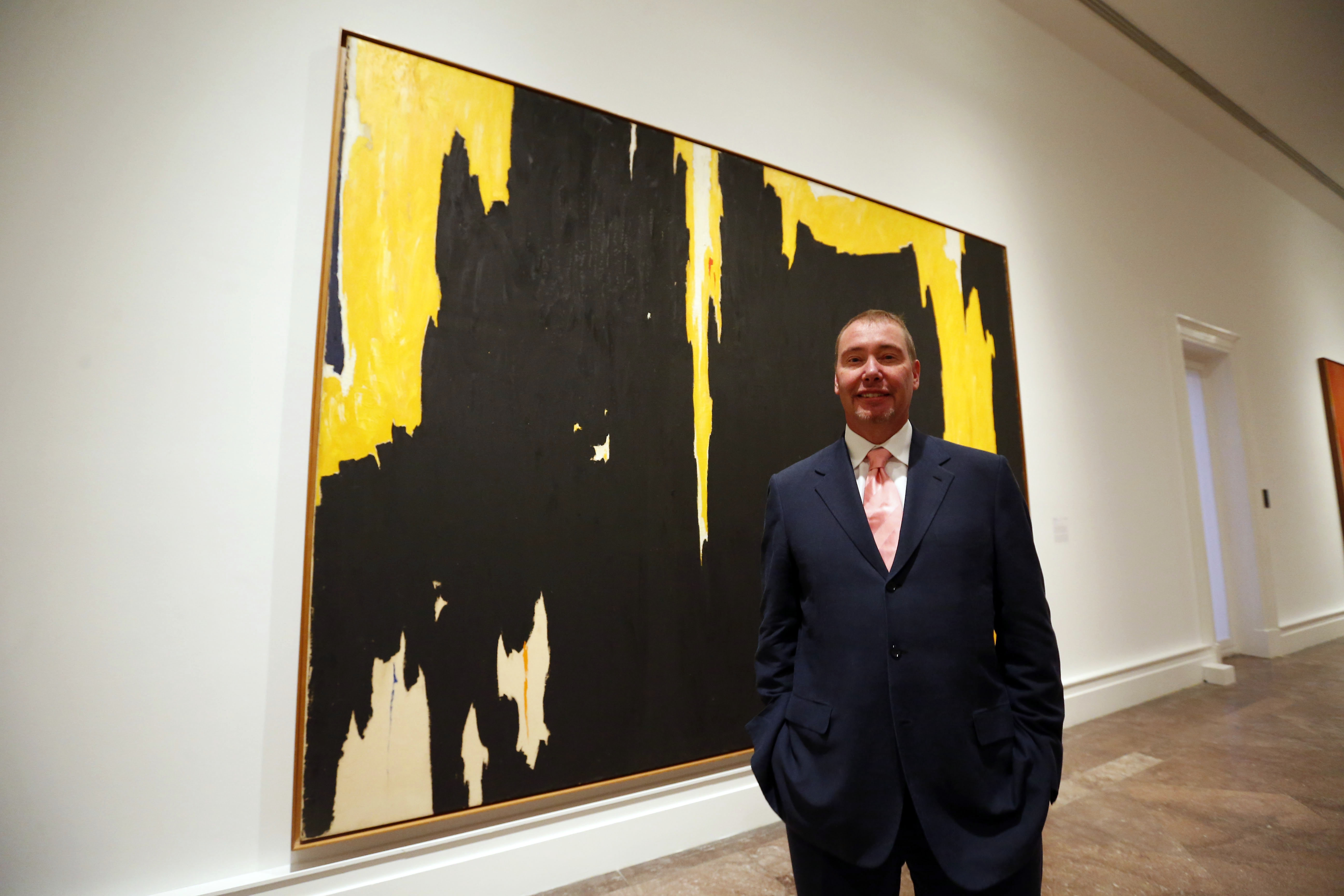 "Jeffery Gundlach stands in front of Clyfford Still's painting ""1957-D No. 1"" in the Albright Knox Art Gallery. (Mark Mulville/Buffalo News)"
