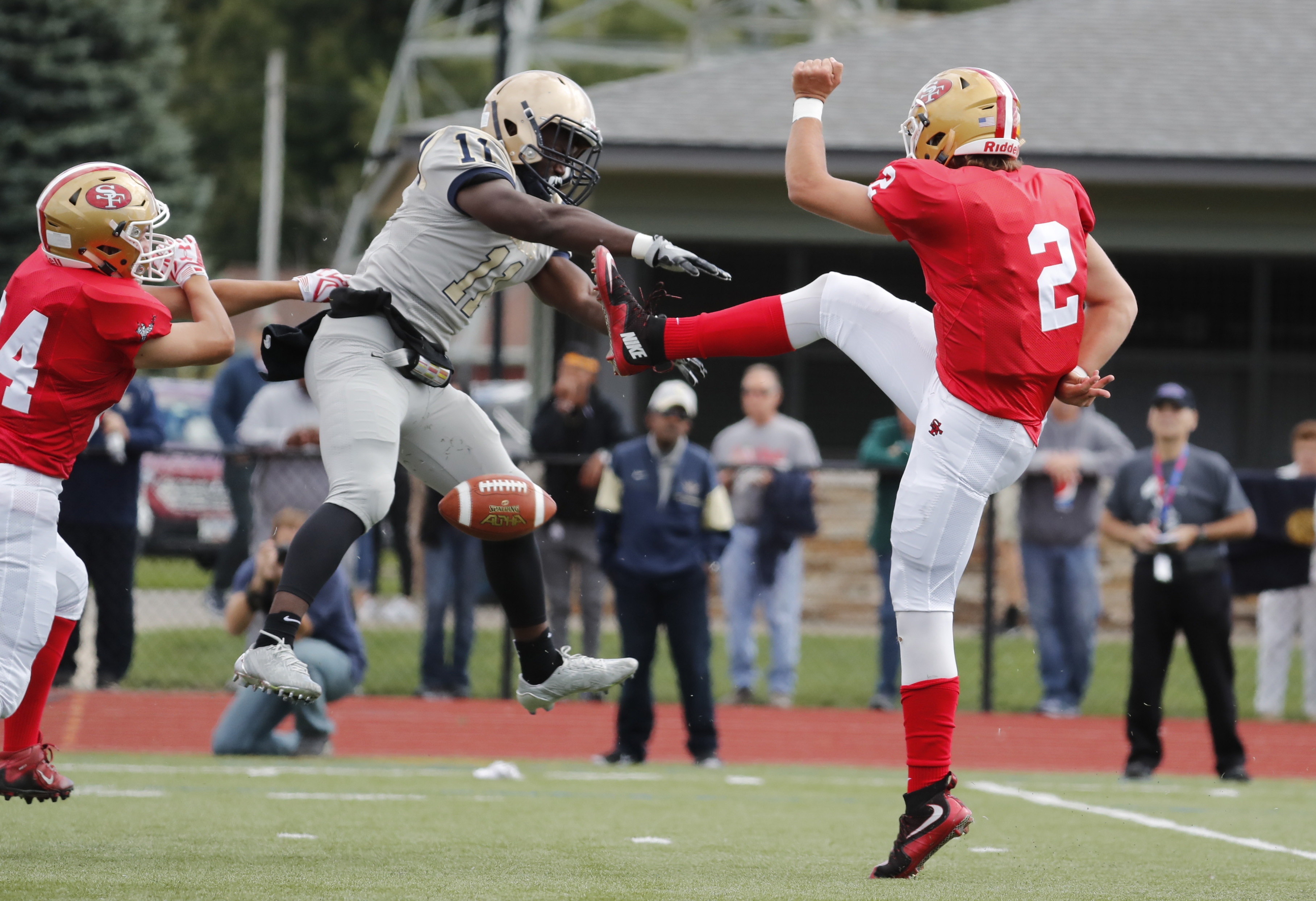 RaeQwon Greer of Canisius blocks a Jerry Hickson punt to set up the first touchdown of the Crusaders' 55-13 victory.