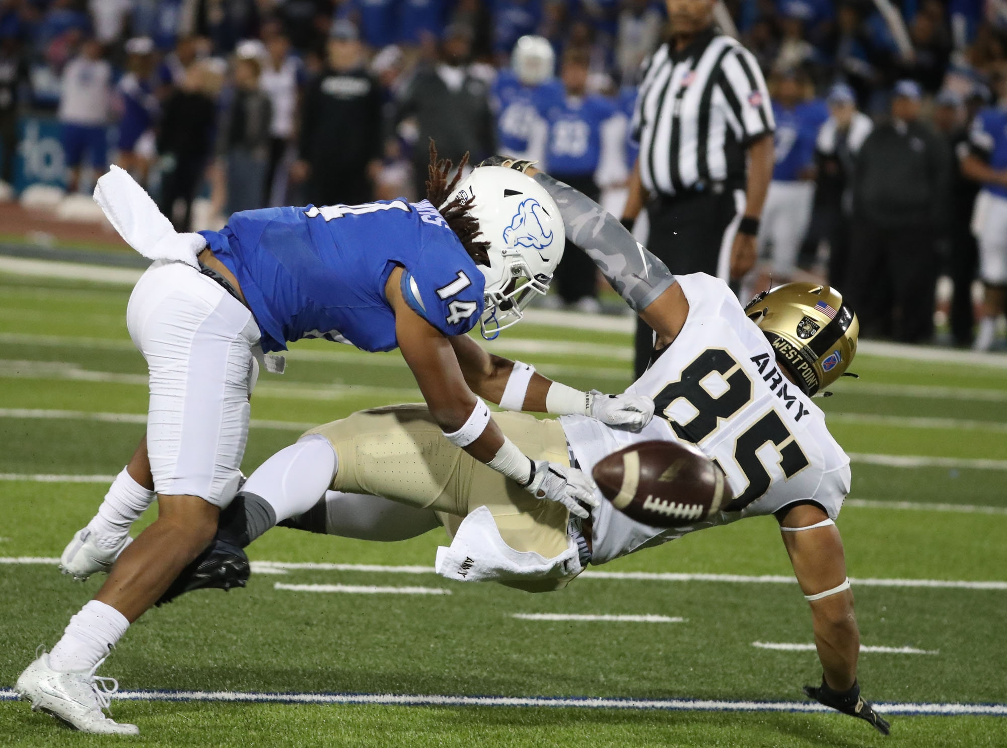 Buffalo Bulls cornerback Brandon Williams (14) breaks up a pass intended for Army Black Knights tight end Quinten Parker (85) in the first quarter at UB Stadium in Amherst, N.Y. on Saturday, Sept. 24, 2016.  (James P. McCoy/ Buffalo News)