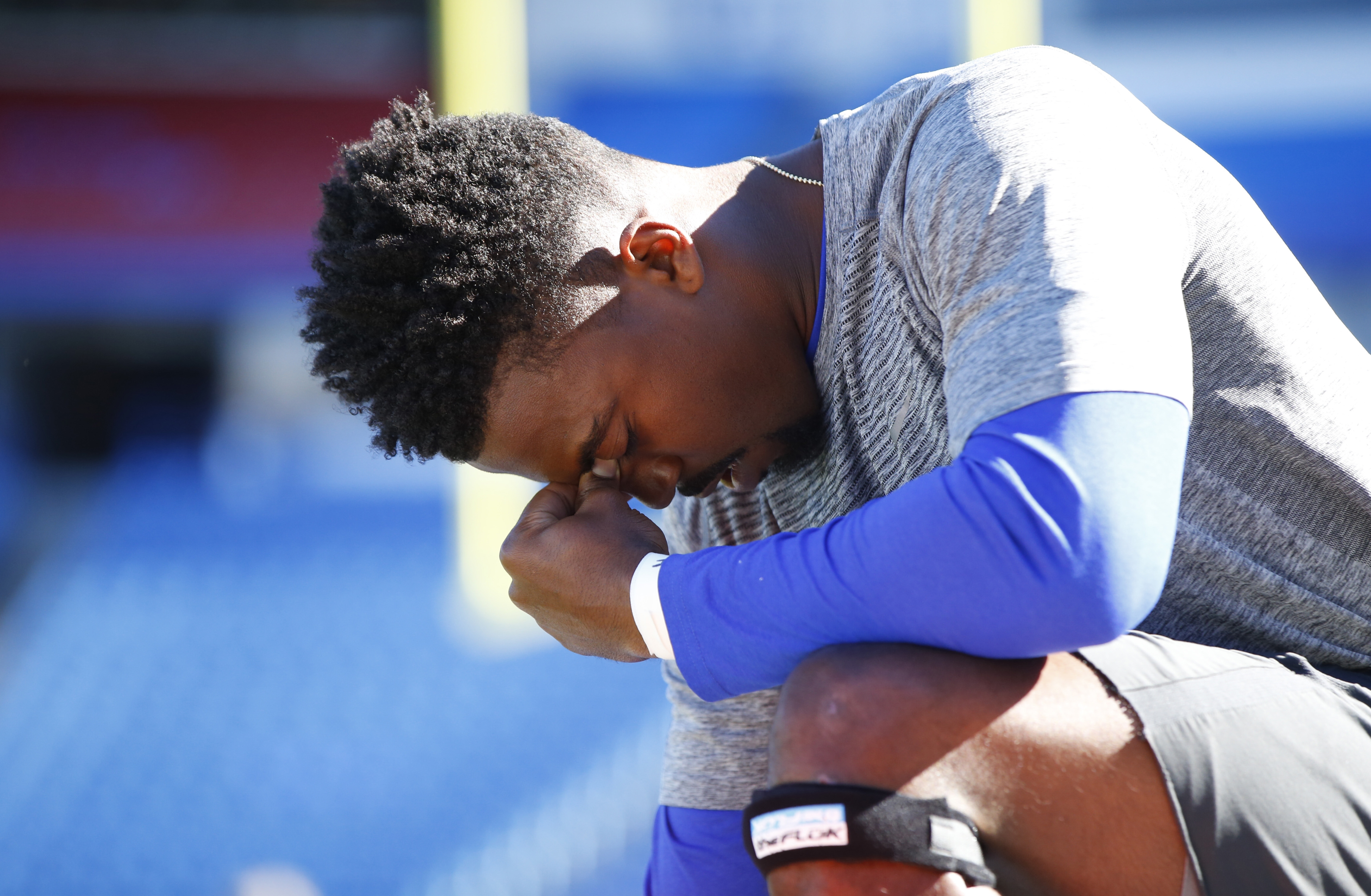 Buffalo Bills quarterback Tyrod Taylor takes a knee and prays prior to pregame against the Arizona Cardinals at New Era Field on Sunday, Sept. 25, 2016.  (Harry Scull Jr./Buffalo News)