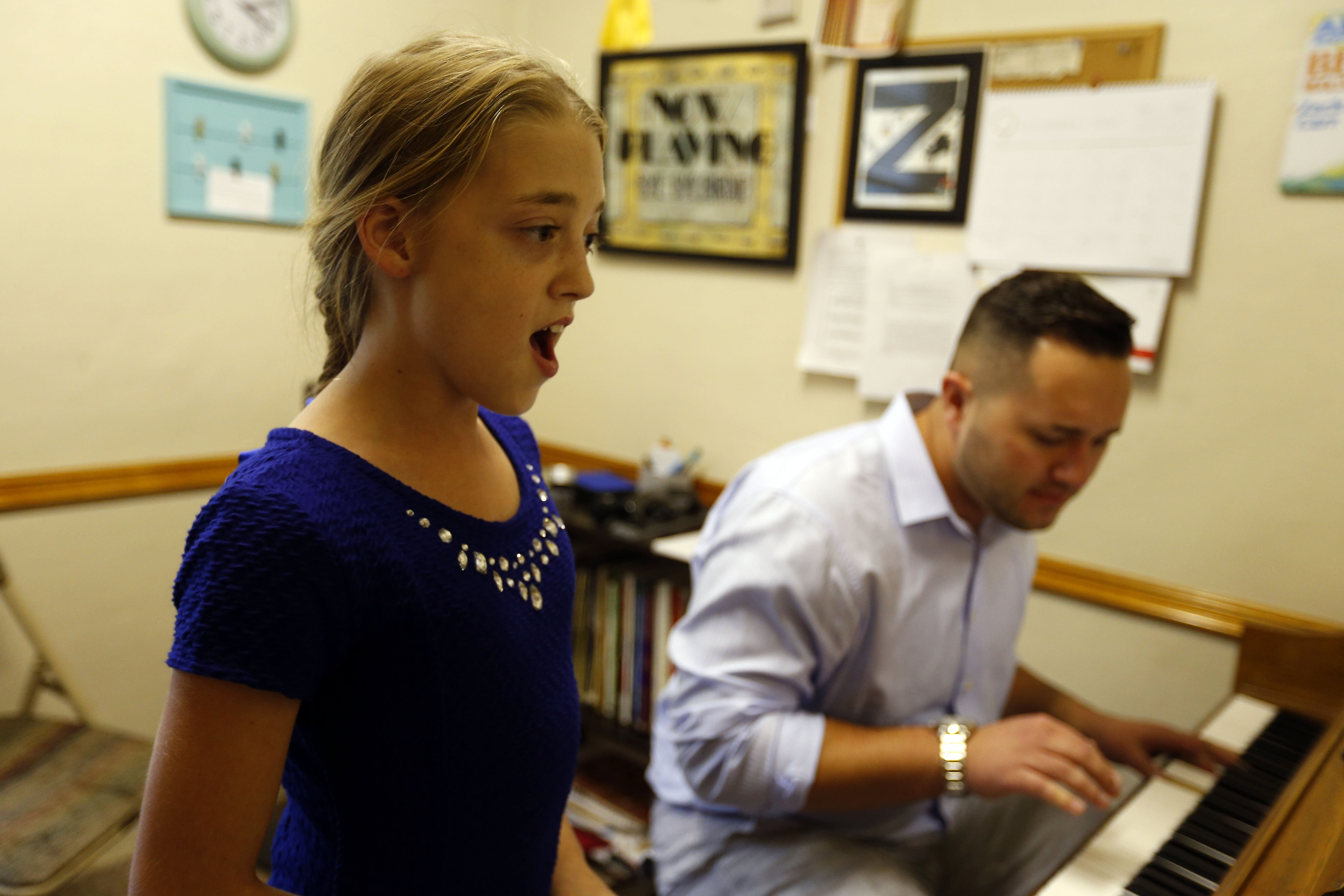 Ally Rose Marella, 11, practices with her vocal instructor, Zack Carr, at Matt's Music Vocal Performance Team in North Tonawanda. Ally Rose also dances and plays piano.