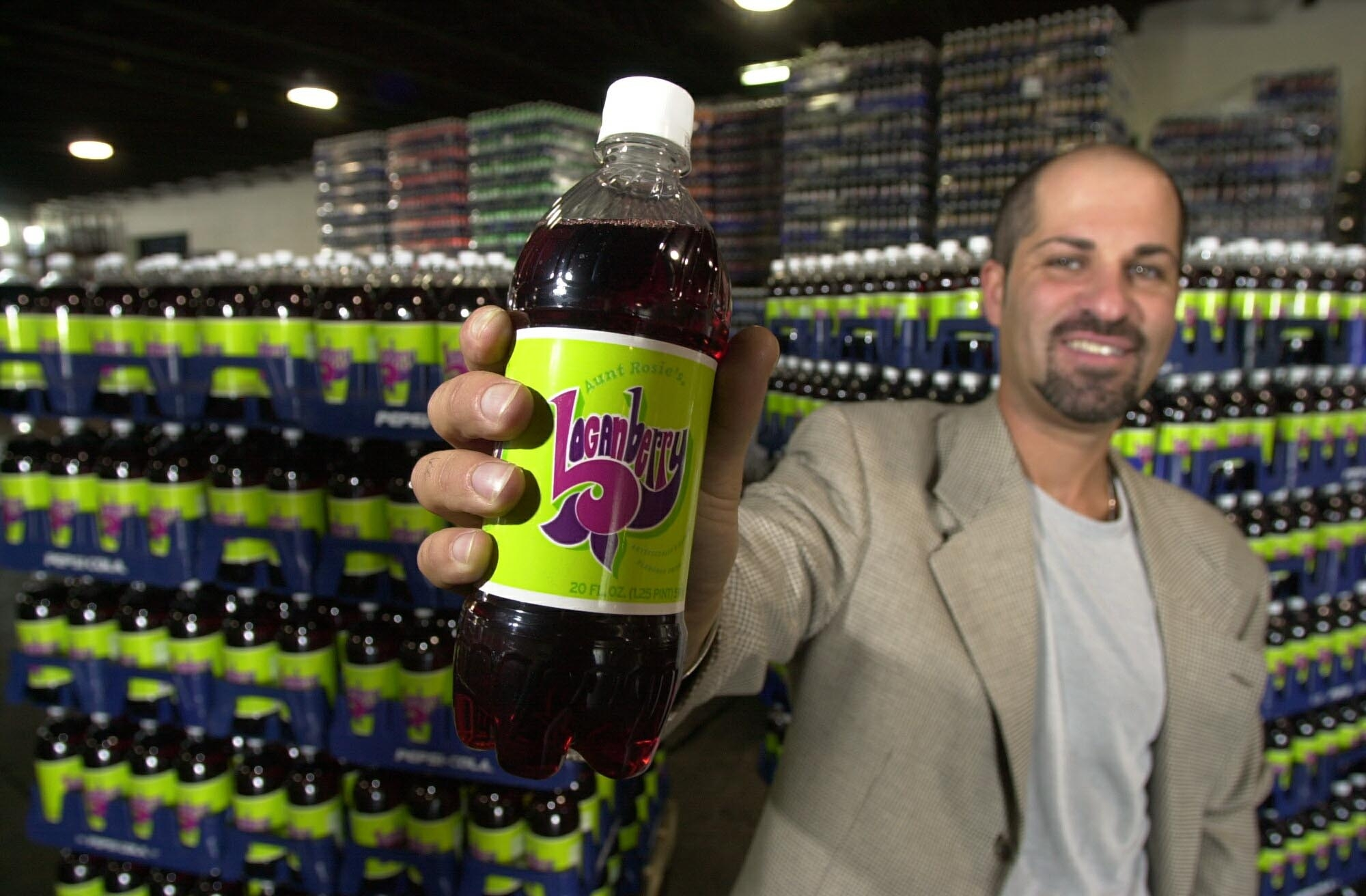 In September 2001, Scott Pastor of Pepsi-Cola Buffalo Bottling posed amid Aunt Rosie's Loganberry at its Walden Avenue plant.