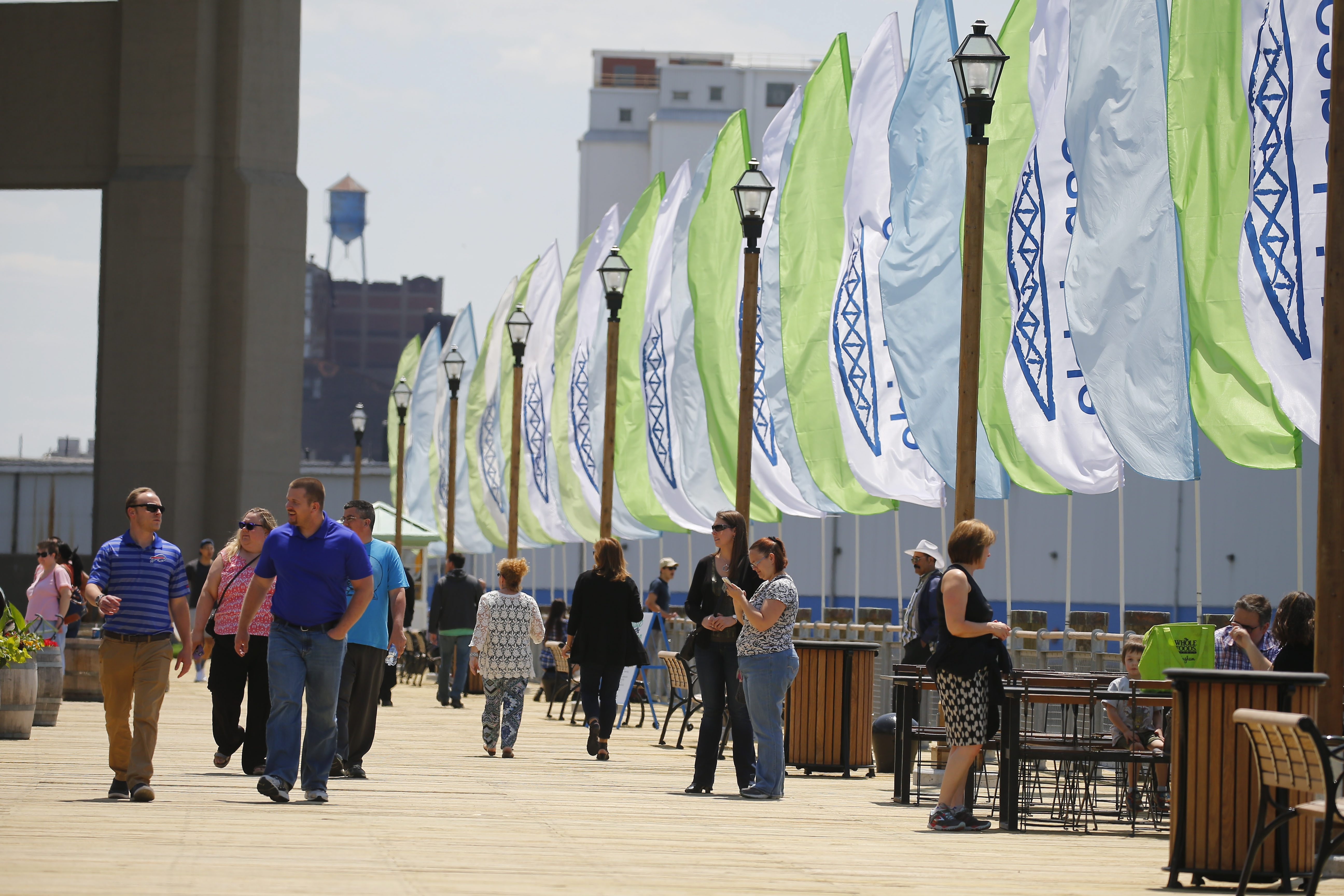 People walk the boardwalk at Canalside in Buffalo in May. (Mark Mulville/Buffalo News file photo)