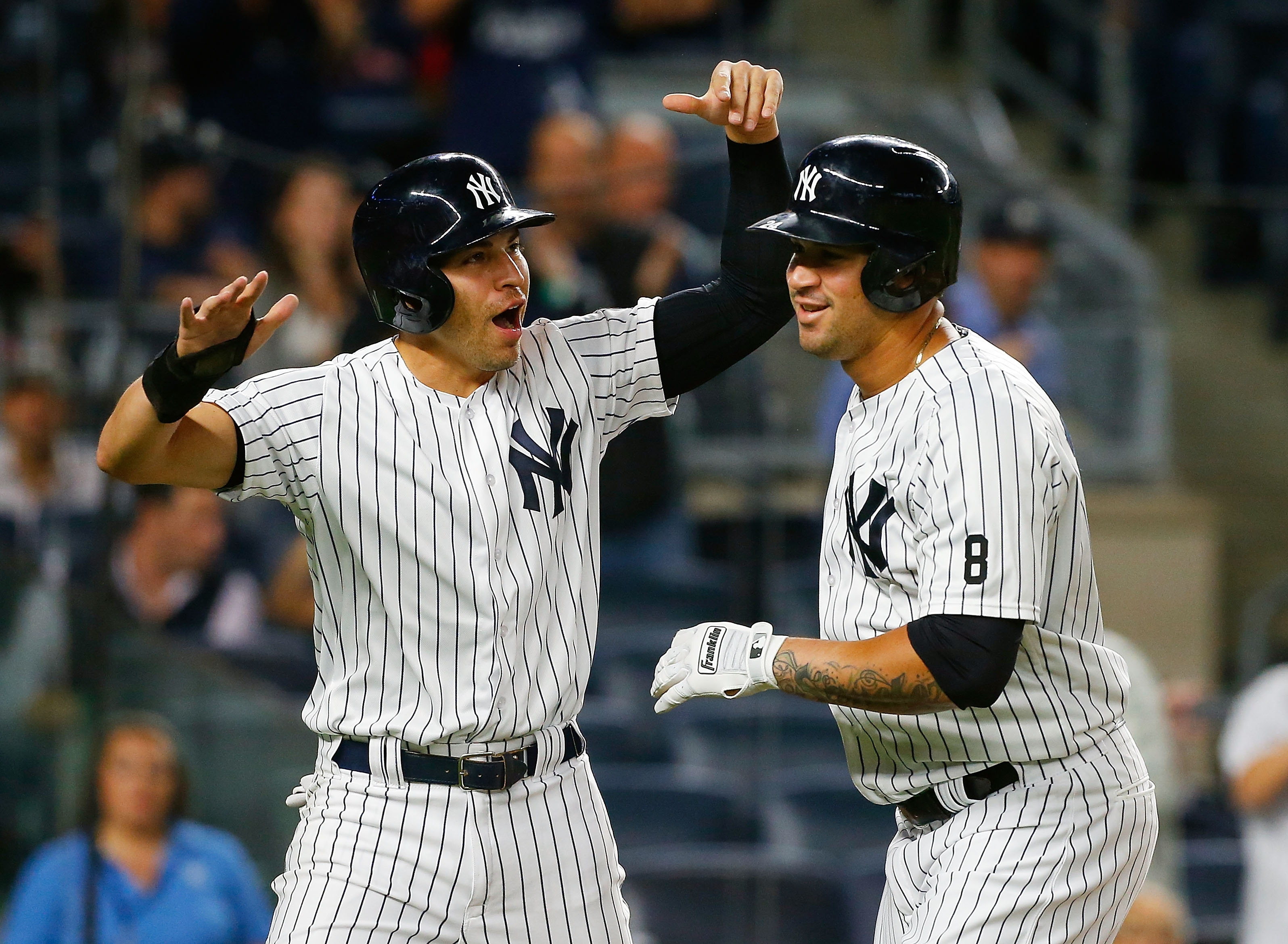 New York's Gary Sanchez celebrates his 20th home run of the season, all since early August, in the first inning rates his first inning two-run home run against the Boston Red Sox with teammate Jacoby Ellsbury #22 at Yankee Stadium on September 27, 2016 in the Bronx borough of New York City.  (Photo by Jim McIsaac/Getty Images)