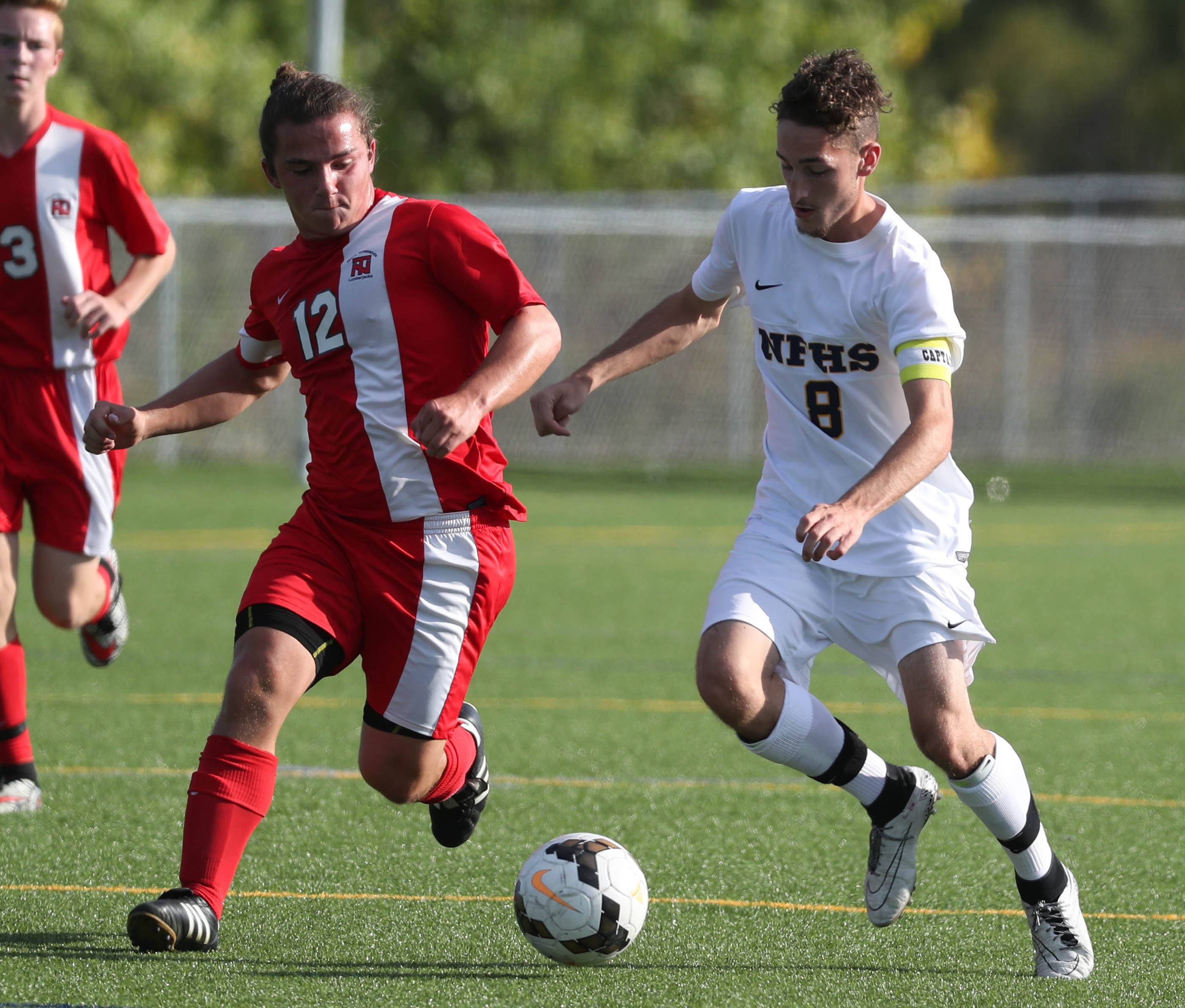 North Tonawanda's Dylan Folger, left, and Niagara Falls' Nick McKean battle for the ball during Falls' 3-2 victory on Wednesday.