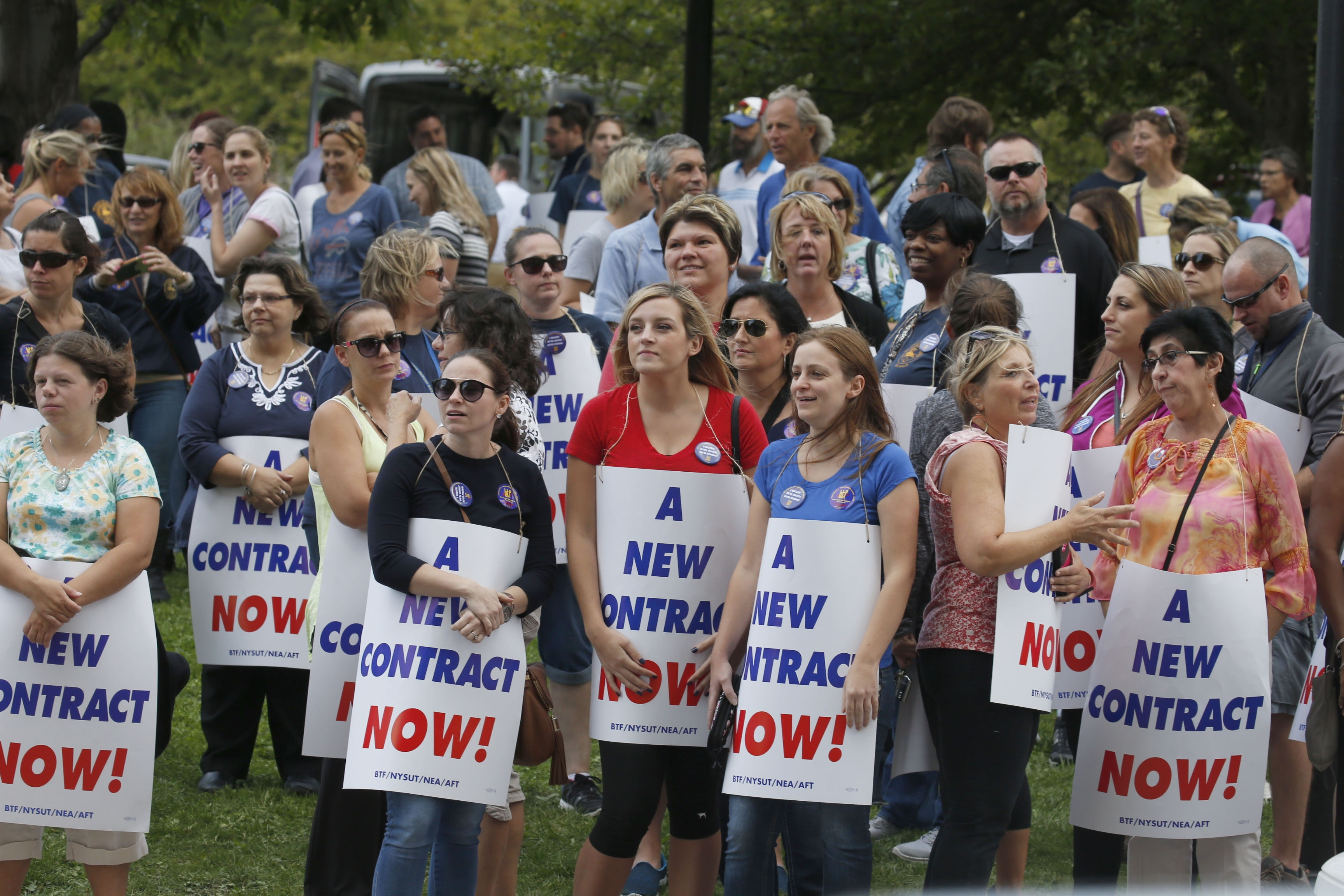Union supporters attend a rally Wednesday outside City Hall, where the Board of Education was meeting.