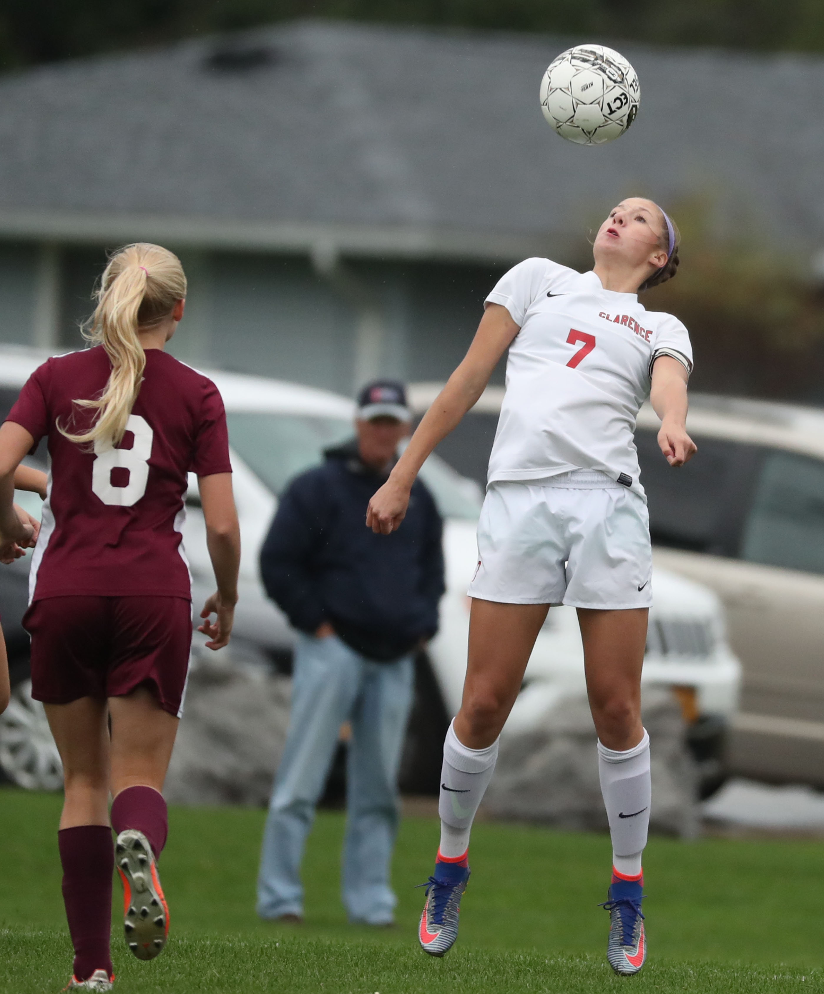 Lauren Cullinen heads the ball away from Orchard Park's Jenna DeHaven during Clarence's 8-0 win in an ECIC I clash Thursday.