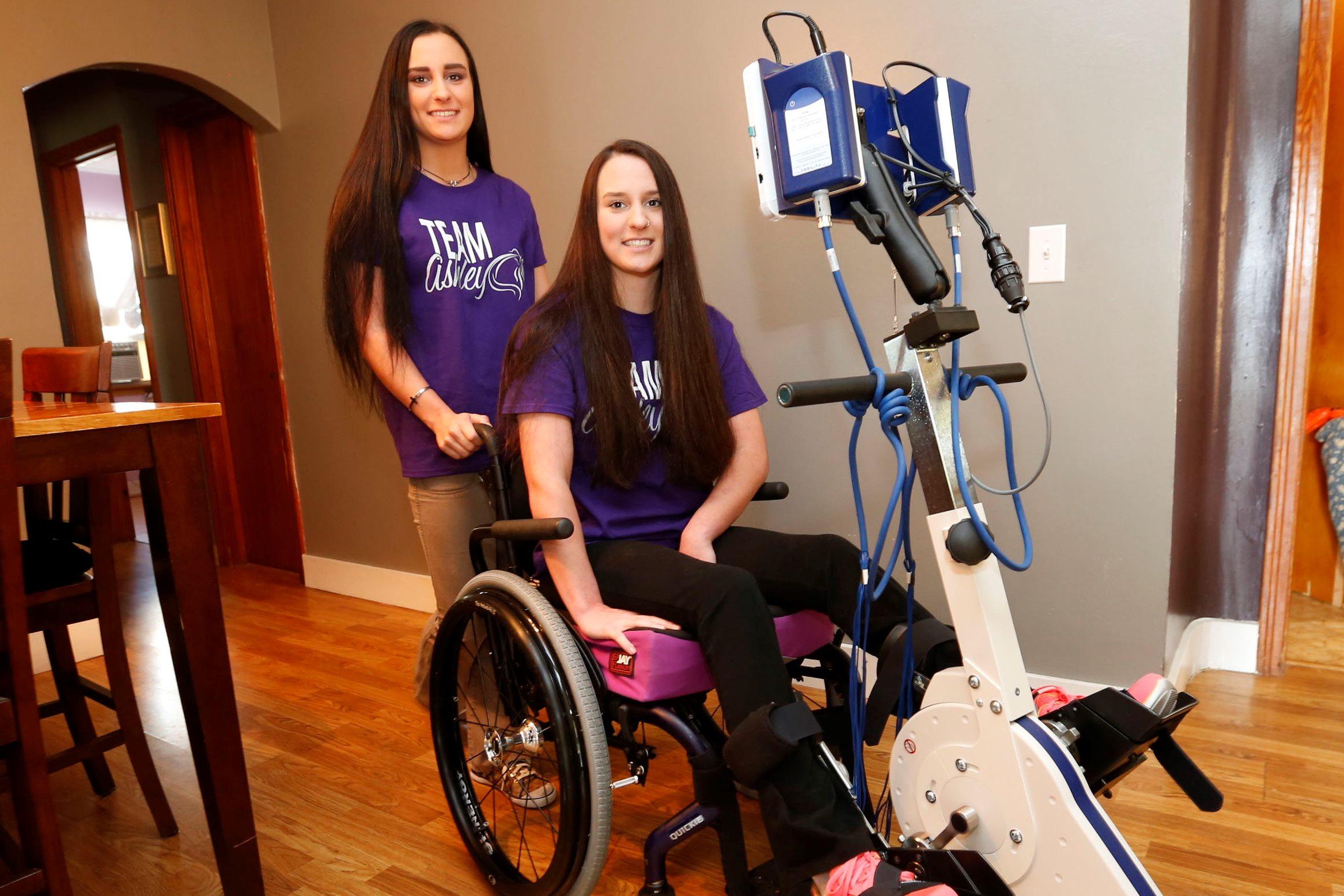 Ashley Kern right, with her twin sister Alex, both 17, at their Cheektowaga home. (Robert Kirkham/Buffalo News)