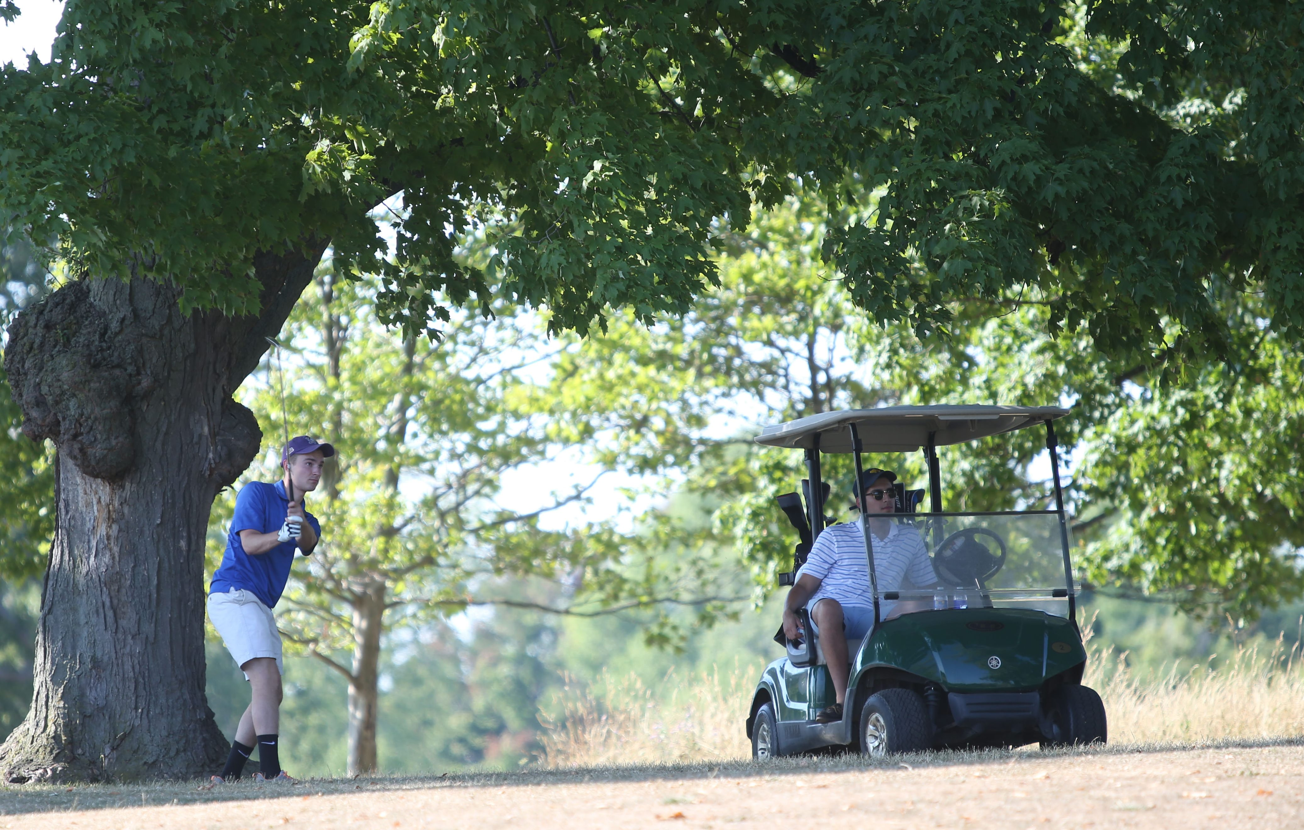 Occasional golfers Collin Rampado, left, and James Ghosen play a round of golf recently in Delaware Park.  (Sharon Cantillon/Buffalo News)
