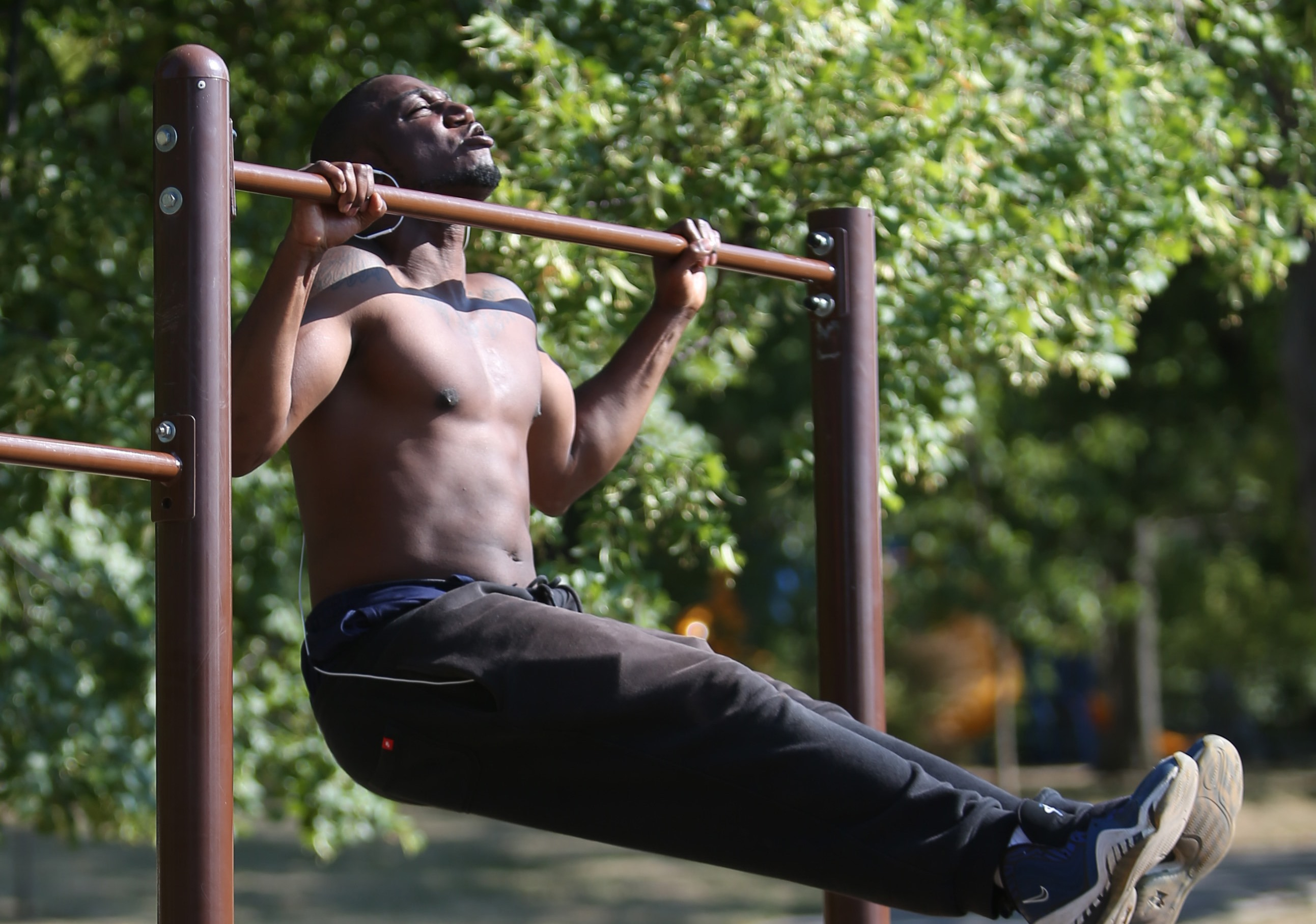 Bernard Bell does pull-ups at Parcourse Fit Center. Though he has a gym membership, Delaware Park is close to his house and very convenient. (Sharon Cantillon/Buffalo News)