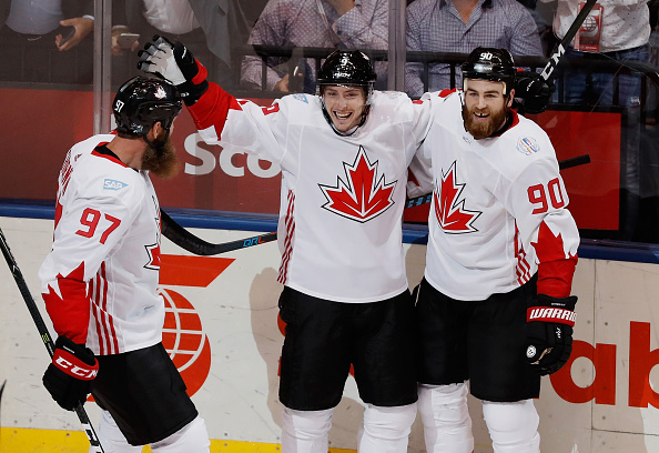 Matt Duchene (middle) celebrates one of his first-period goals with Joe Thornton (97) and Sabres center Ryan O'Reilly (90) in Team Canada's victory (Getty Images).