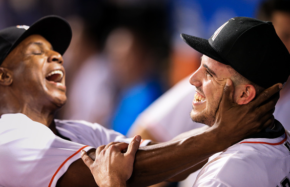 Jose Fernandez (right) got a kiss on the cheek from Marlins hitting coach Barry Bonds after pitching eight shutout innings with 12 strikeouts Tuesday vs. Washington in what turned out to be the final game of his life (Getty Images).