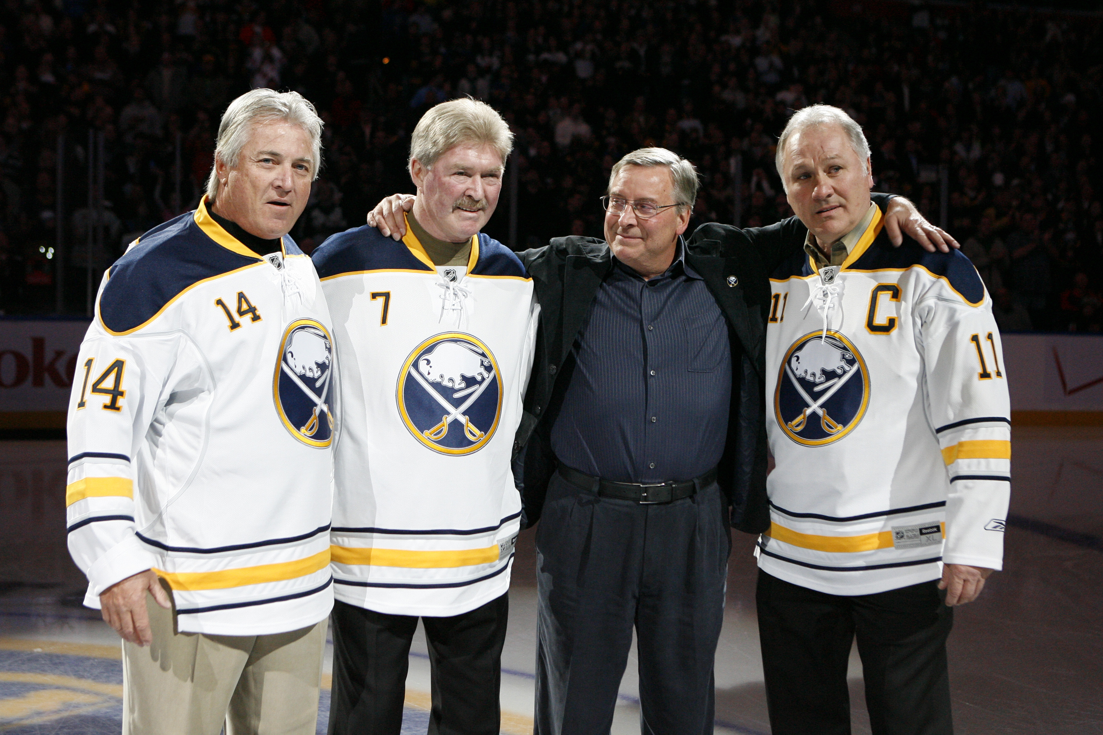 Buffalo Sabres owner Terry Pegula meets the French Connection, Rene Robert, Rick Martin and Gilbert Perreault, before a game Feb. 23, 2011. {James P. McCoy / Buffalo News}