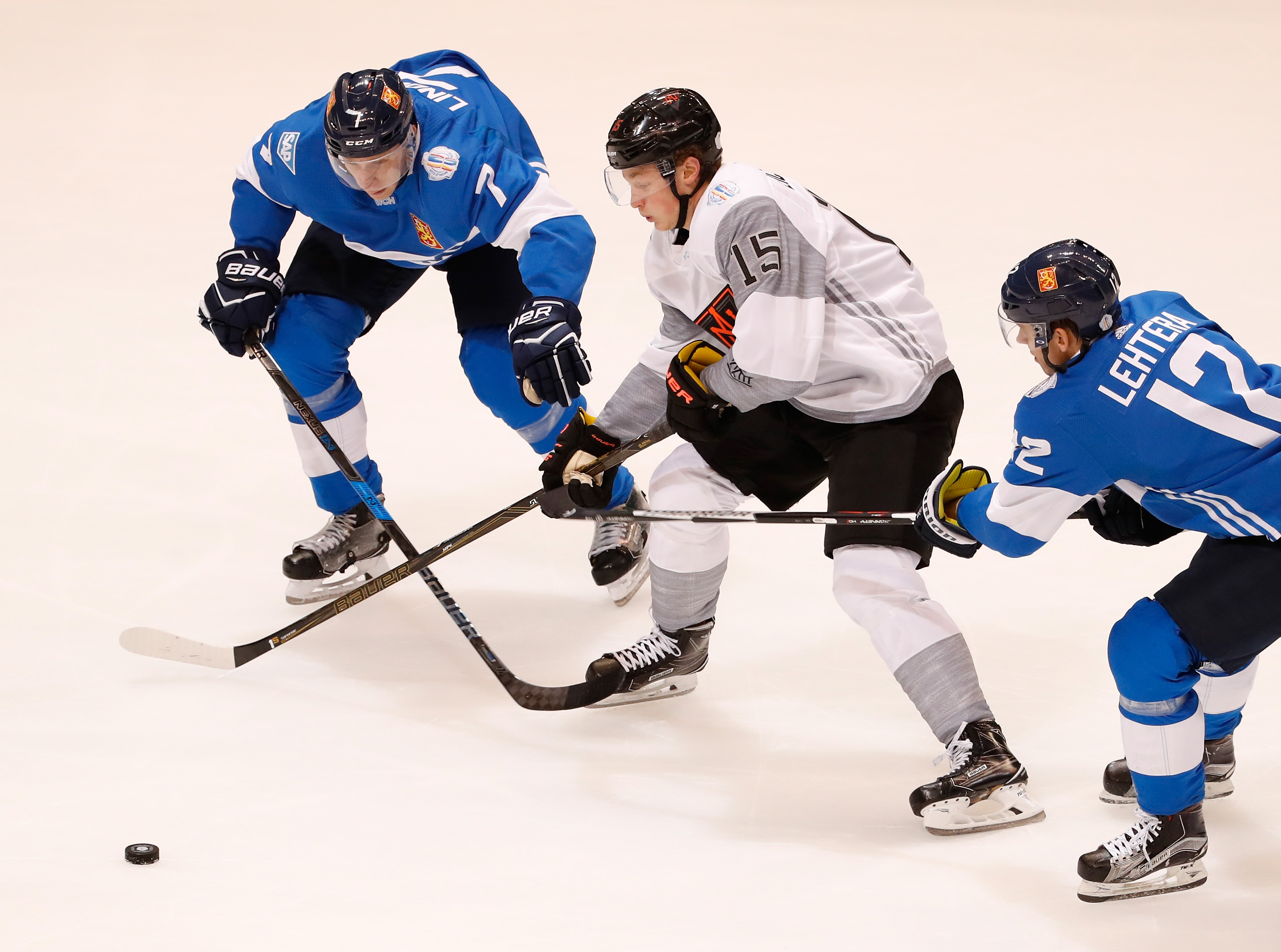 TORONTO, ON - SEPTEMBER 18: Jack Eichel #15 of Team North America tries to get around Esa Lindell #7 of Team Finland in the first period during the World Cup of Hockey at the Air Canada Center on September 18, 2016 in Toronto, Canada. (Photo by Gregory Shamus/Getty Images)