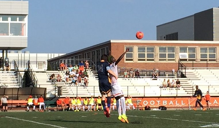 Buffalo State's Bass Sarr, in white, rises for a header against Medaille. (Ben Tsujimoto/Buffalo News)