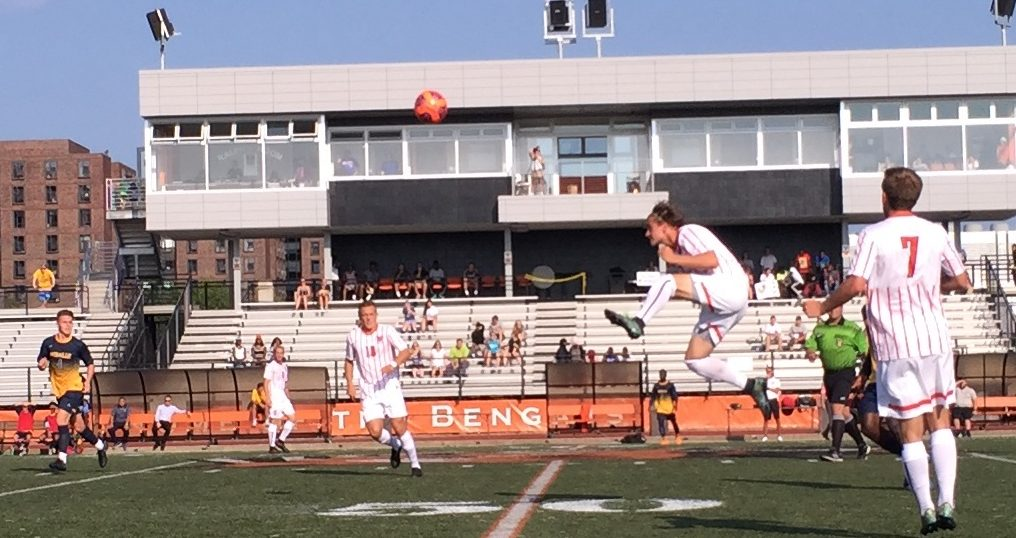 Buffalo State holding midfielder Victor Powell, in mid-air, wins a header against Medaille. (Ben Tsujimoto/Buffalo News)