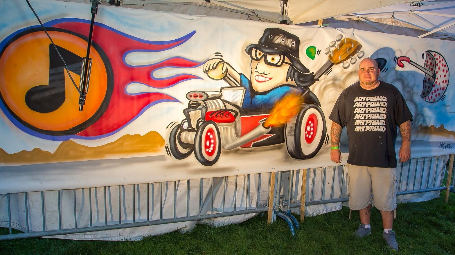 Artist Vinny Alejandro portrays Robby Takac, Music Is Art's founder, riding in style. (Don Nieman/Special to The News)