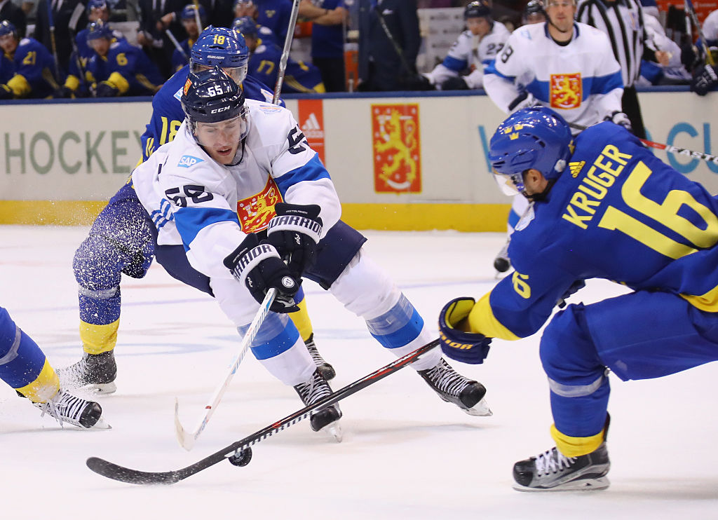 Sabres defenseman Rasmus Ristolainen of Finland, working Tuesday against Sweden's Marcus Kruger, needs a win and some help to make the semifinals (Getty Images).