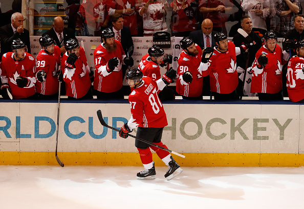 Sidney Crosby gets the plaudits from the Team Canada bench, including Sabres center Ryan O'Reilly (90), after his first-period goal (Getty Images).