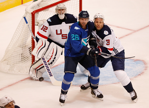 Thomas Vanek works against Team USA defenseman Jack Johnson during Saturday's game (Getty Images).