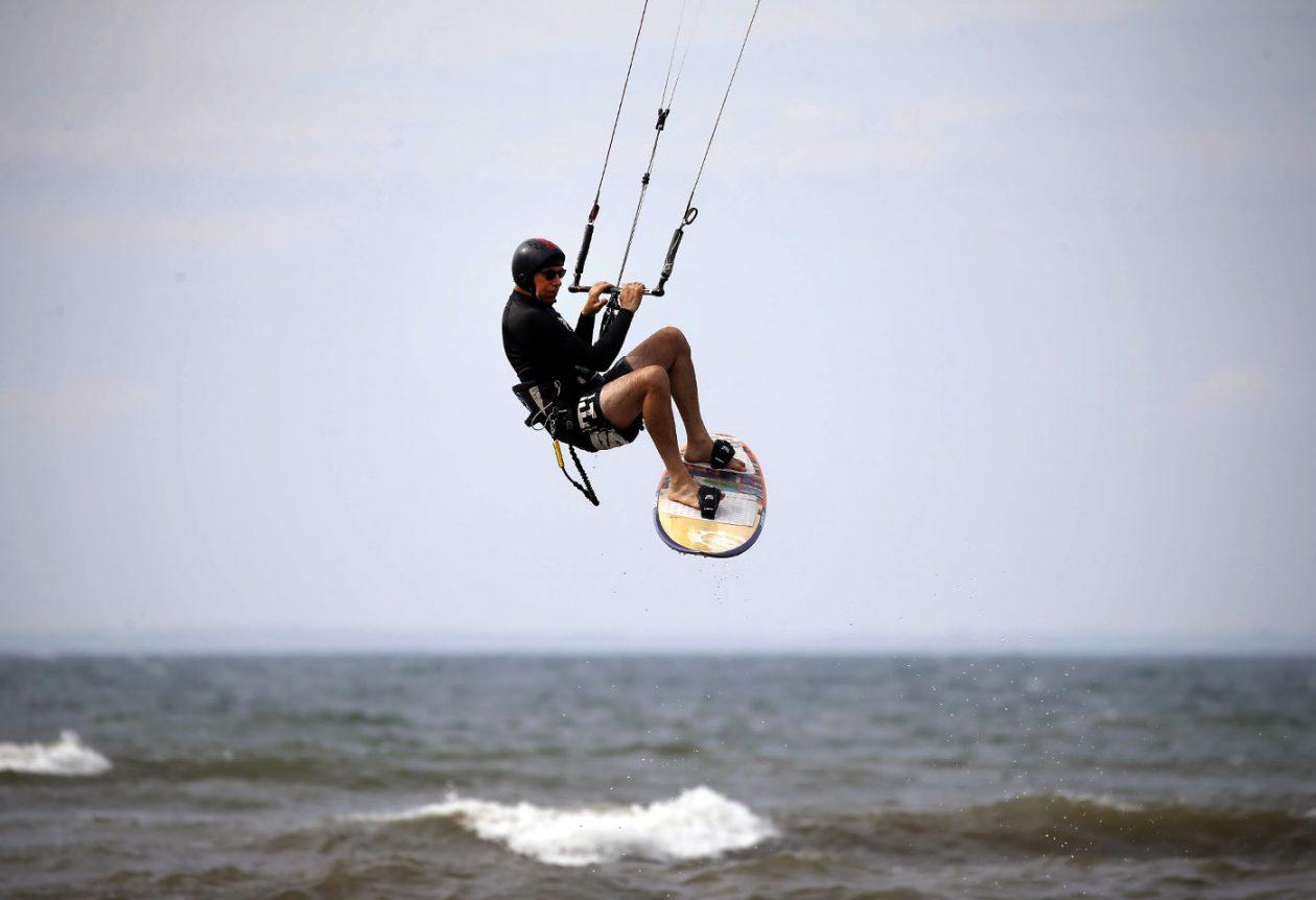 pictures, Scott Pearson takes to the air as he kitesurfs off Hamburg Beach Thursday, September 8, 2016. (Mark Mulville/Buffalo News)