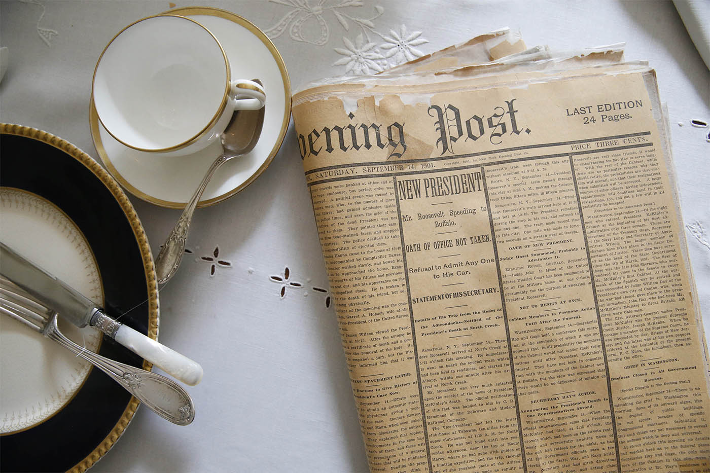 Pictures, The display in the dining room of the Wilcox Mansion includes a copy of the the Evening Post from Sept. 14, 1901 featuring news articles about President Theodore Roosevelt's inauguration, Wednesday, Sept. 7, 2016. (Derek Gee/Buffalo News)