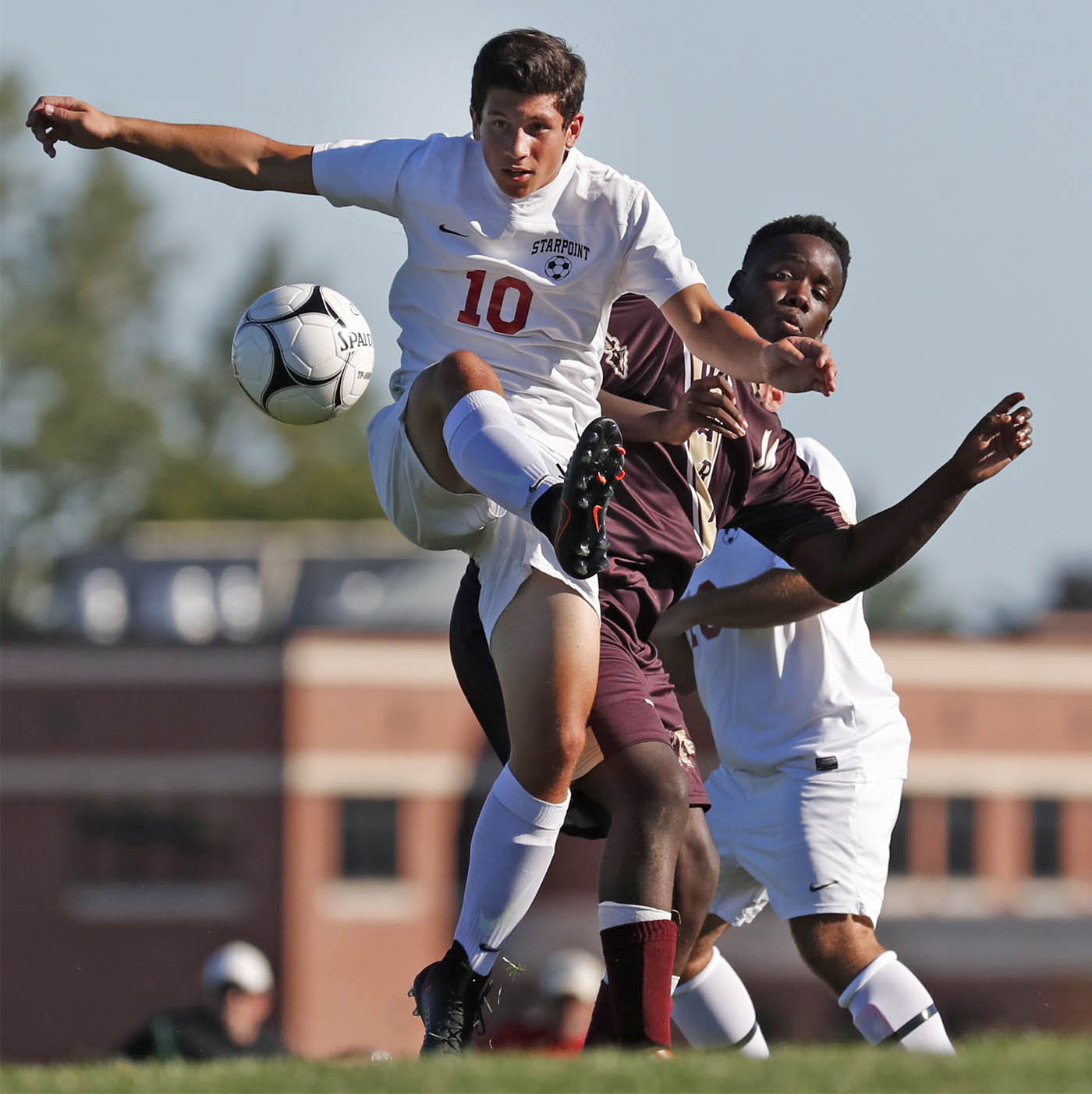 Pictures, Cheektowaga's Yanick Ndjibu battle for a loose ball with Starpoint's Max Balko during first half action at Starpoint high school on Monday, Sept. 12, 2016. (Harry Scull Jr./Buffalo News)