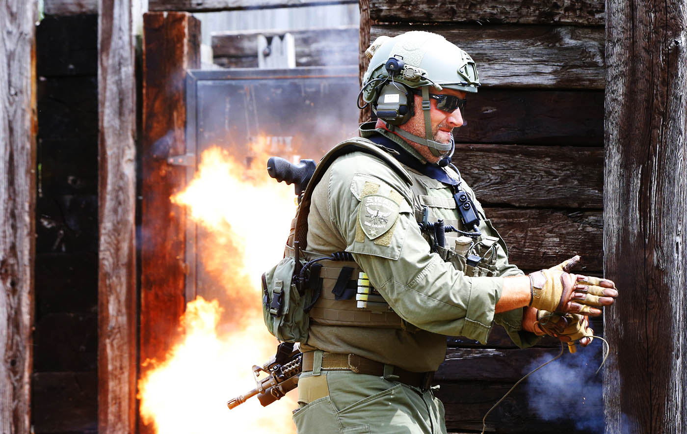 Pictures, Matt Noecker, SWAT team squad leader initiates a explosive charge during monthly Erie County Sheriff SWAT training at the Erie County Sheriff's Department Tactical Range in Alden,NY on Thursday, July 14, 2016. (Harry Scull Jr./Buffalo News)