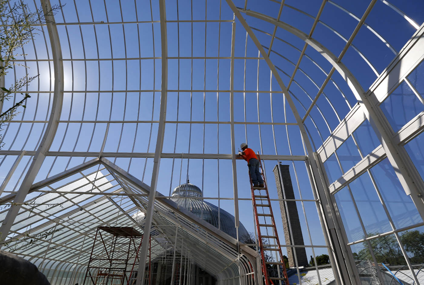 Pictures, Jose Morales works on the frame of the greenhouse at the Buffalo and Erie County Botanical Gardens in Buffalo Tuesday, September 13, 2016. (Mark Mulville/Buffalo News)