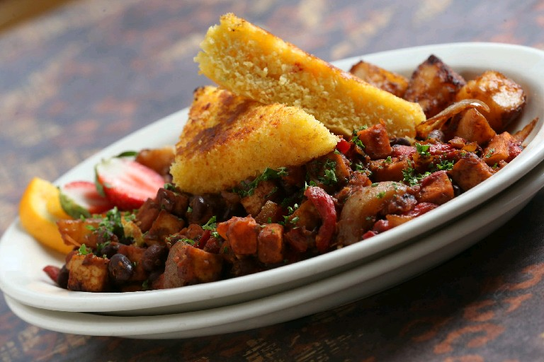 Betty's restaurant boasts a Scrambled Tofu Hash that contains sweet potatoes and black beans, which both contain healthy carbohydrates. (Sharon Cantillon/Buffalo News file photo)