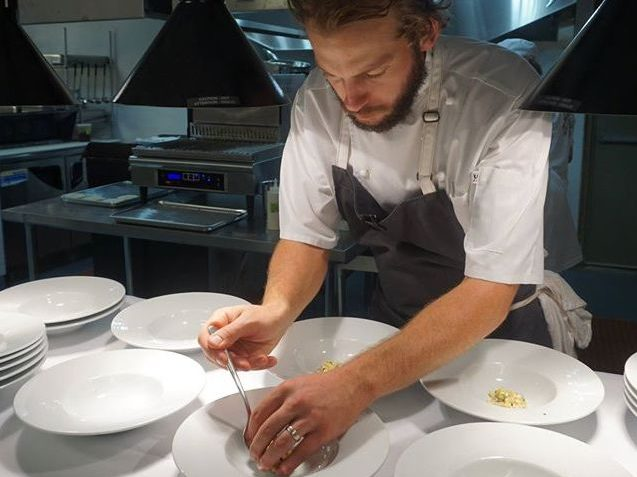 Chef Brian Kiendl plates corn bisque at The White Carrot, his new Chautauqua County restaurant. (Photo: The White Carrot)