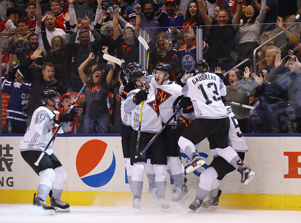 Team North America players mob Nathan MacKinnon after his overtime winner against Sweden (Getty Images).
