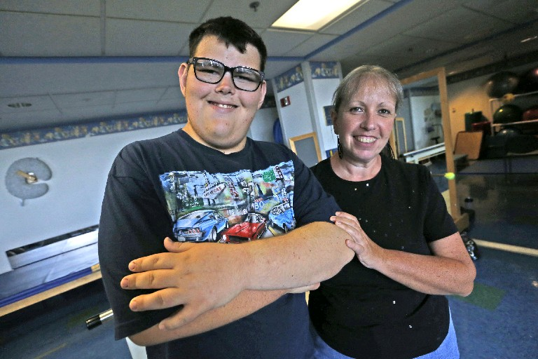 Ethan Milich and his mother, Jennifer, both have benefited from the Healthy Weigh program. (Robert Kirkham/Buffalo News)